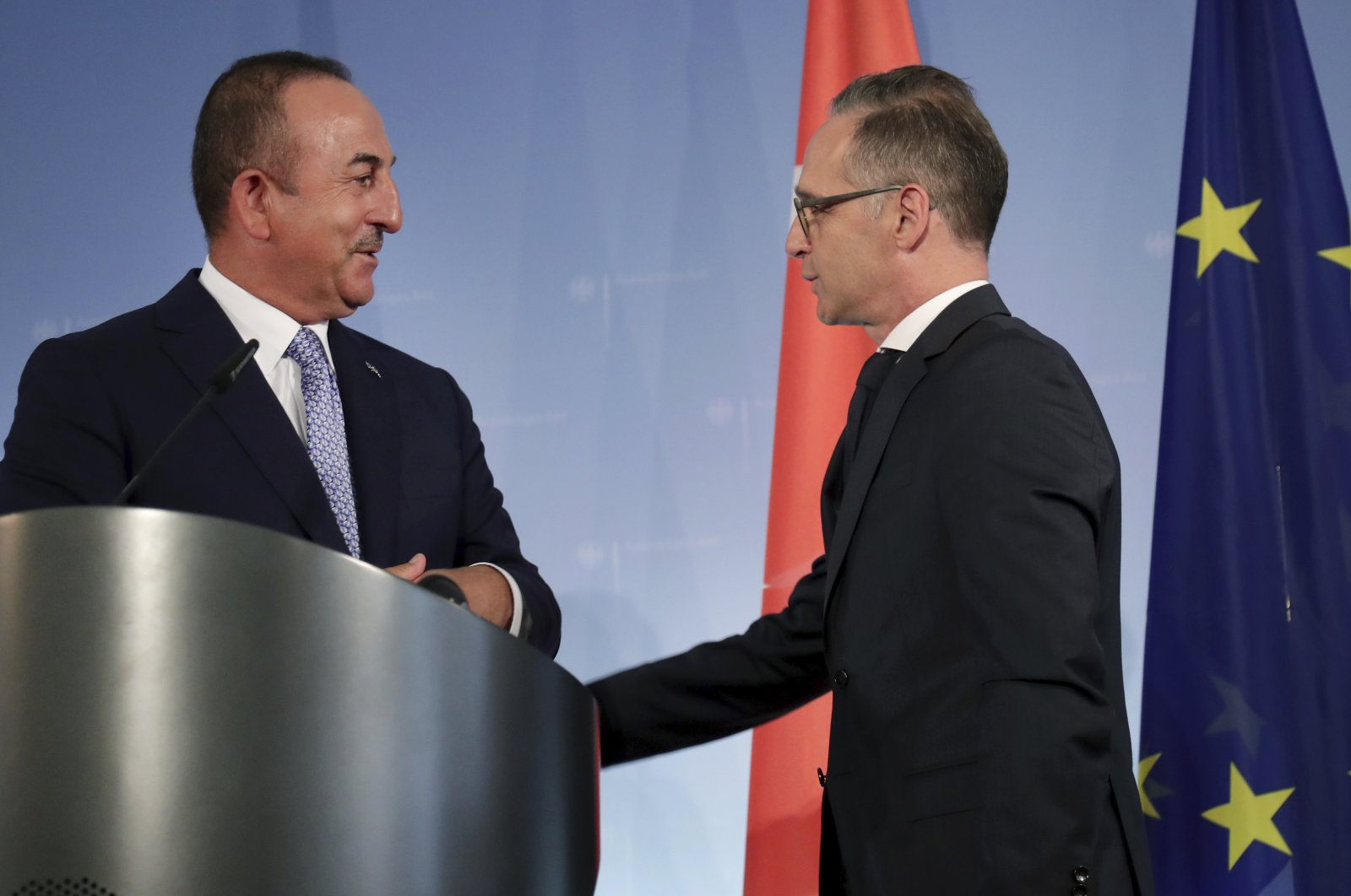 German Foreign Minister Heiko Maas (R) and Turkish Foreign Minister Mevlüt Çavuşoğlu (L) talk after a joint news conference following a meeting in Berlin, Germany, July 2, 2020. (AP Photo)