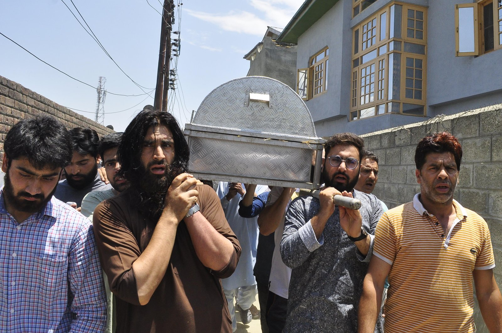 Relatives and neighbors carry the coffin of civilian Bashir Ahmed Khan during his funeral, Srinagar, July 1, 2020. (AA Photo)