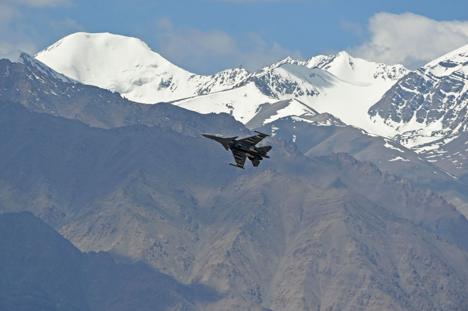 An Indian fighter jet flies over Leh, the joint capital of the union territory of Ladakh, on June 26, 2020. (AFP Photo)