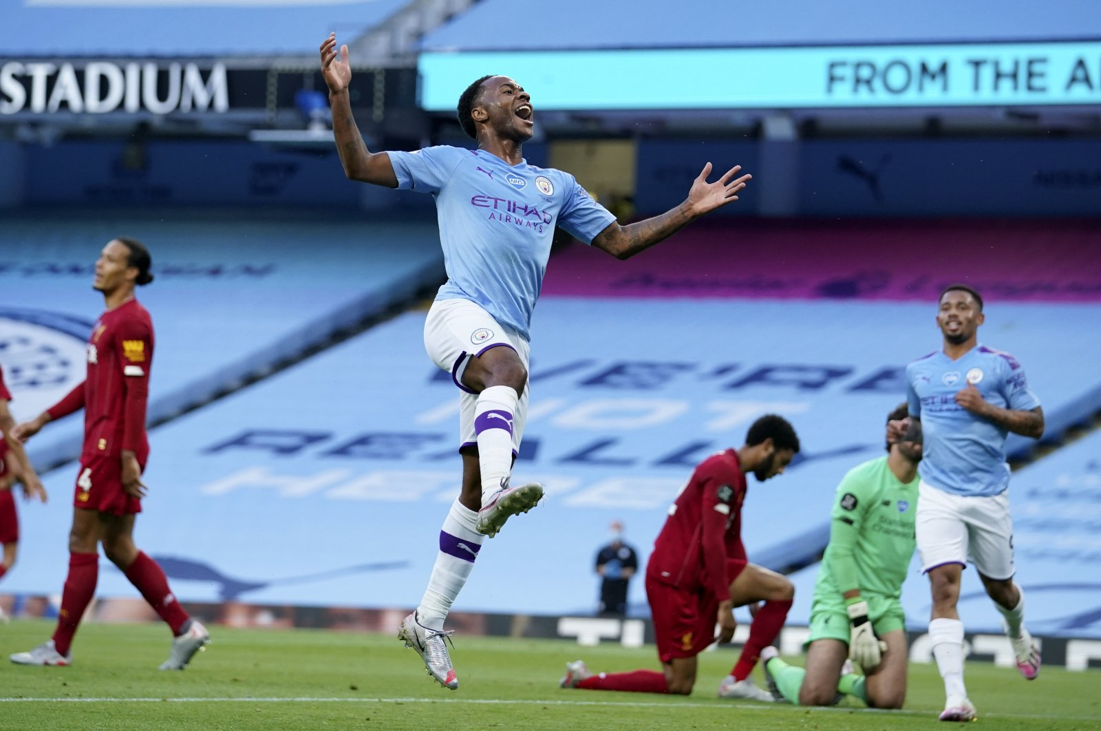 Manchester City's Raheem Sterling celebrates after scoring his team's second goal during the Premier League match against Liverpool in Manchester, England, July 2, 2020. (AP Photo)