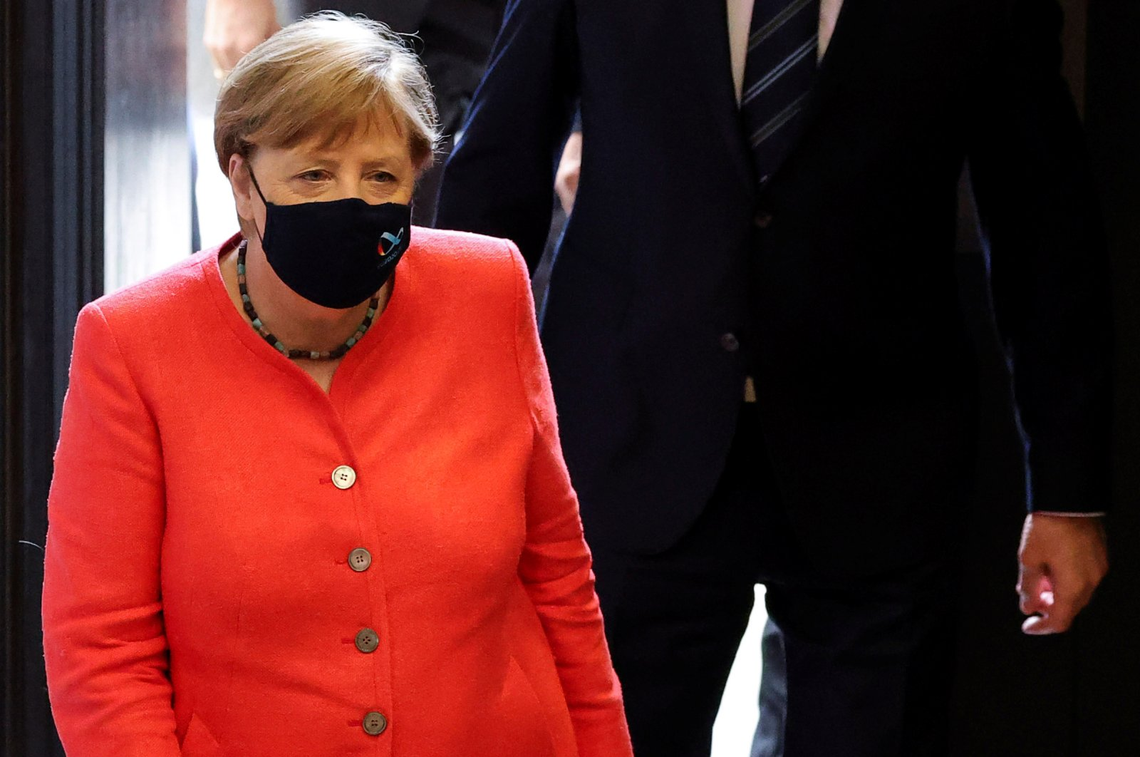 German Chancellor Angela Merkel wearing a face mask arrives to attend a session at the upper house of the German parliament Bundesrat, amid the outbreak of the coronavirus disease (COVID-19), in Berlin, July 3, 2020. (Reuters Photo)