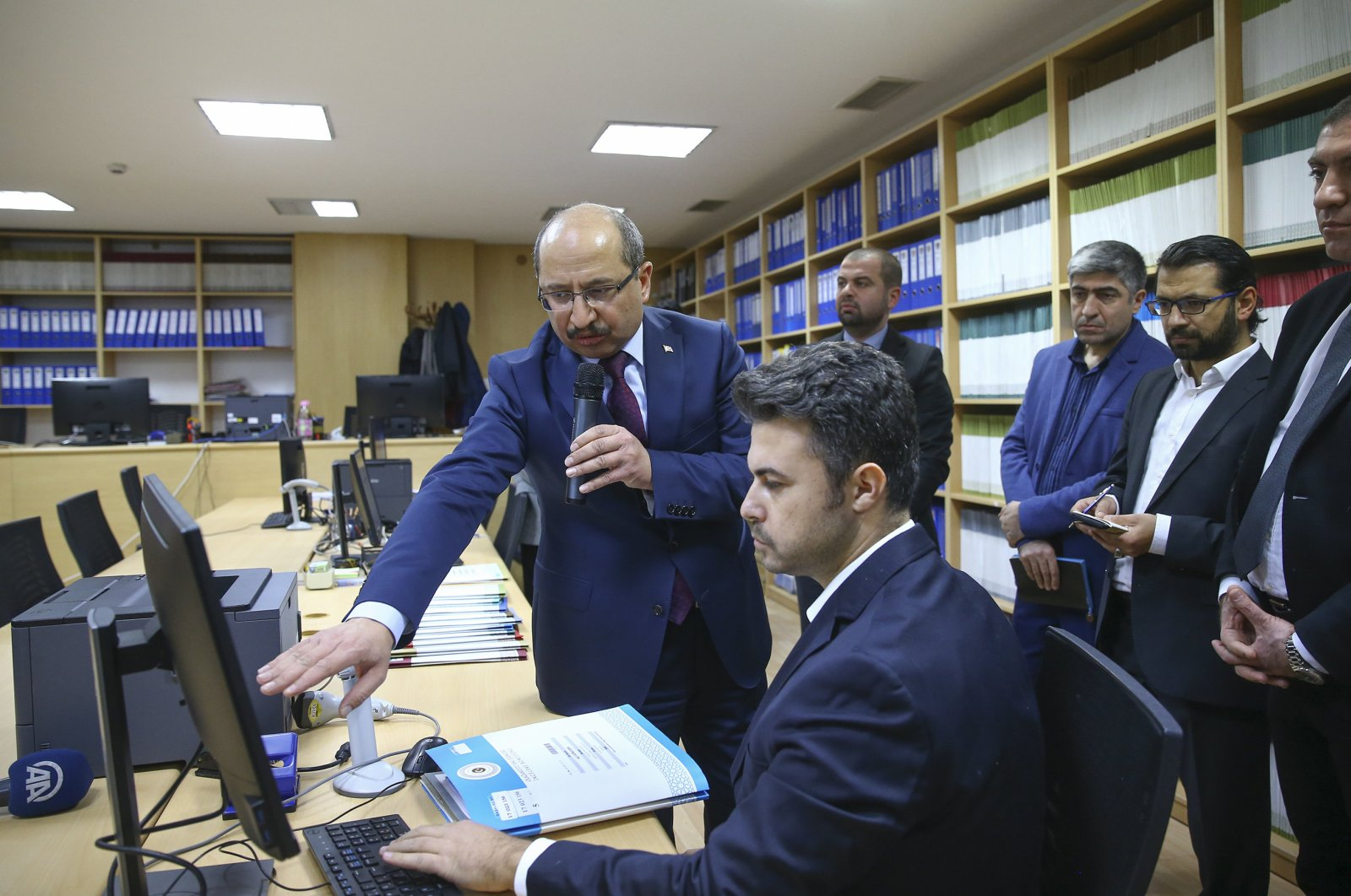 Commission head Salih Tanrıkulu (L) speaking on the processes at the Inquiry Commission on the Emergency Measures archives in Ankara, Dec. 27, 2019. (AA Photo)