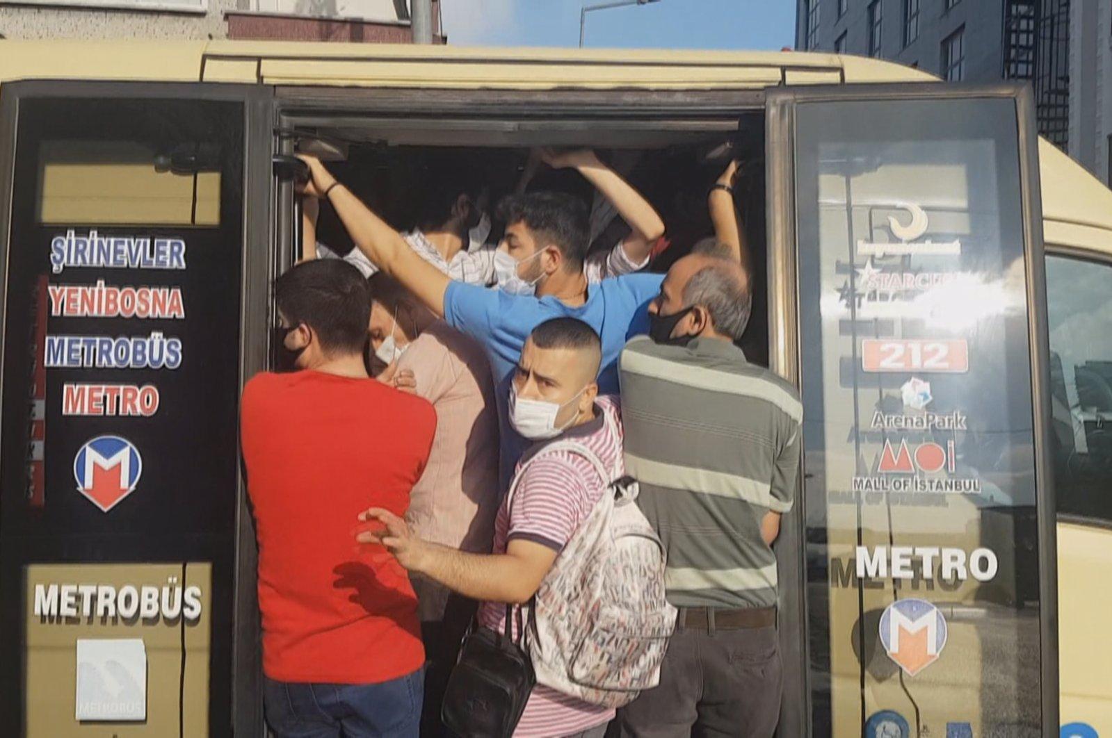 People defy social distancing warnings in an overcrowded minibus in Küçükçekmece district, in Istanbul, Turkey, July 2, 2020. (DHA Photo)