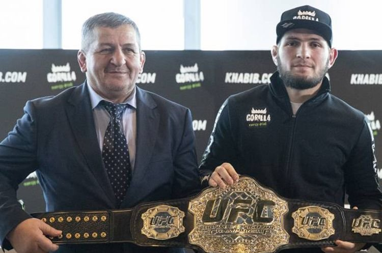 Abdulmanap Nurmagomedov (L), the father and longtime trainer of UFC star Khabib Nurmagomedov, with his son. (AP Photo)
