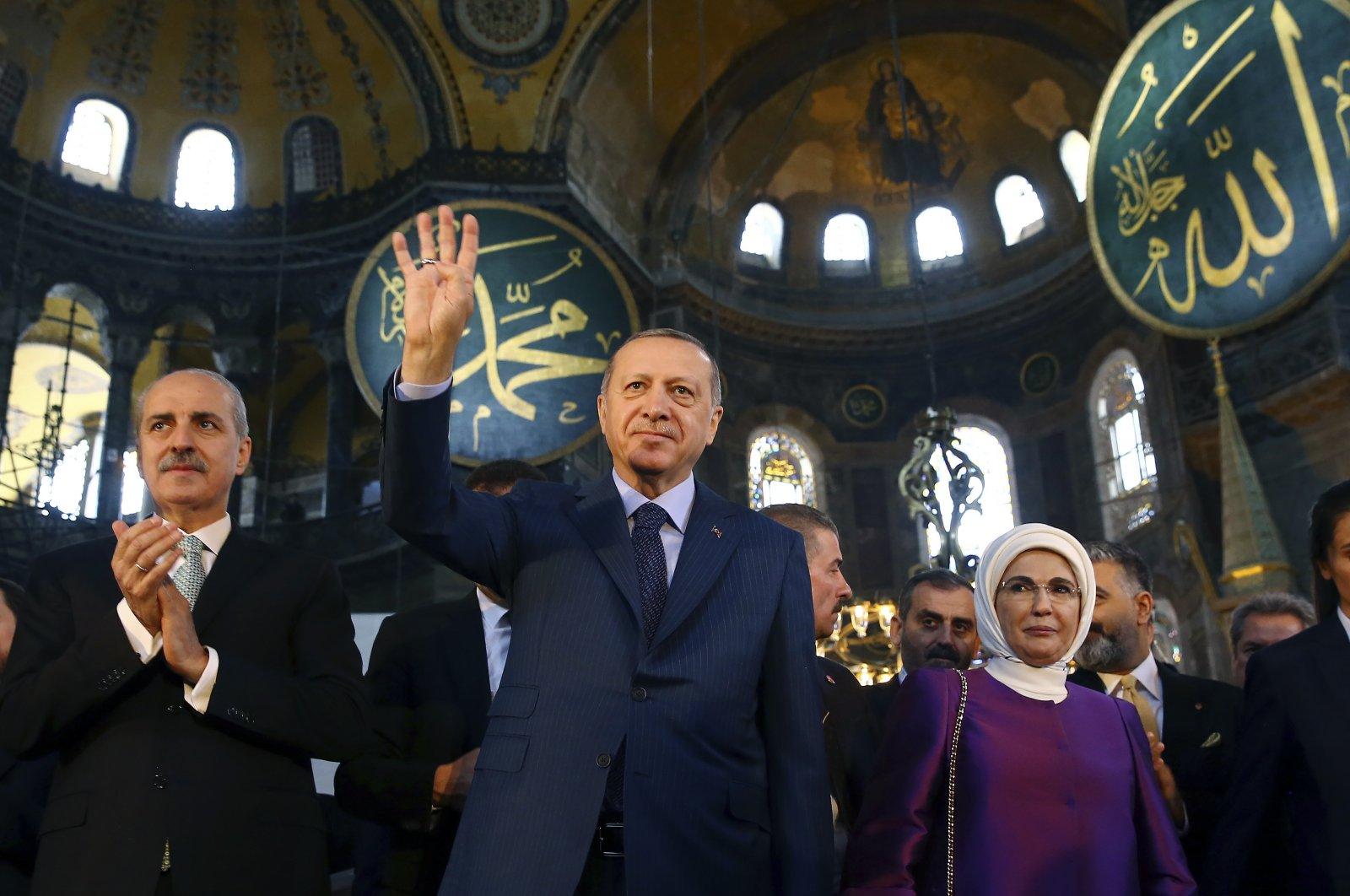 President Recep Tayyip Erdoğan accompanied by his wife Emine Erdoğan waves to supporters as he walks in the Hagia Sophia in the historic Sultanahmet district of Istanbul, March 31, 2018. (AP Photo)