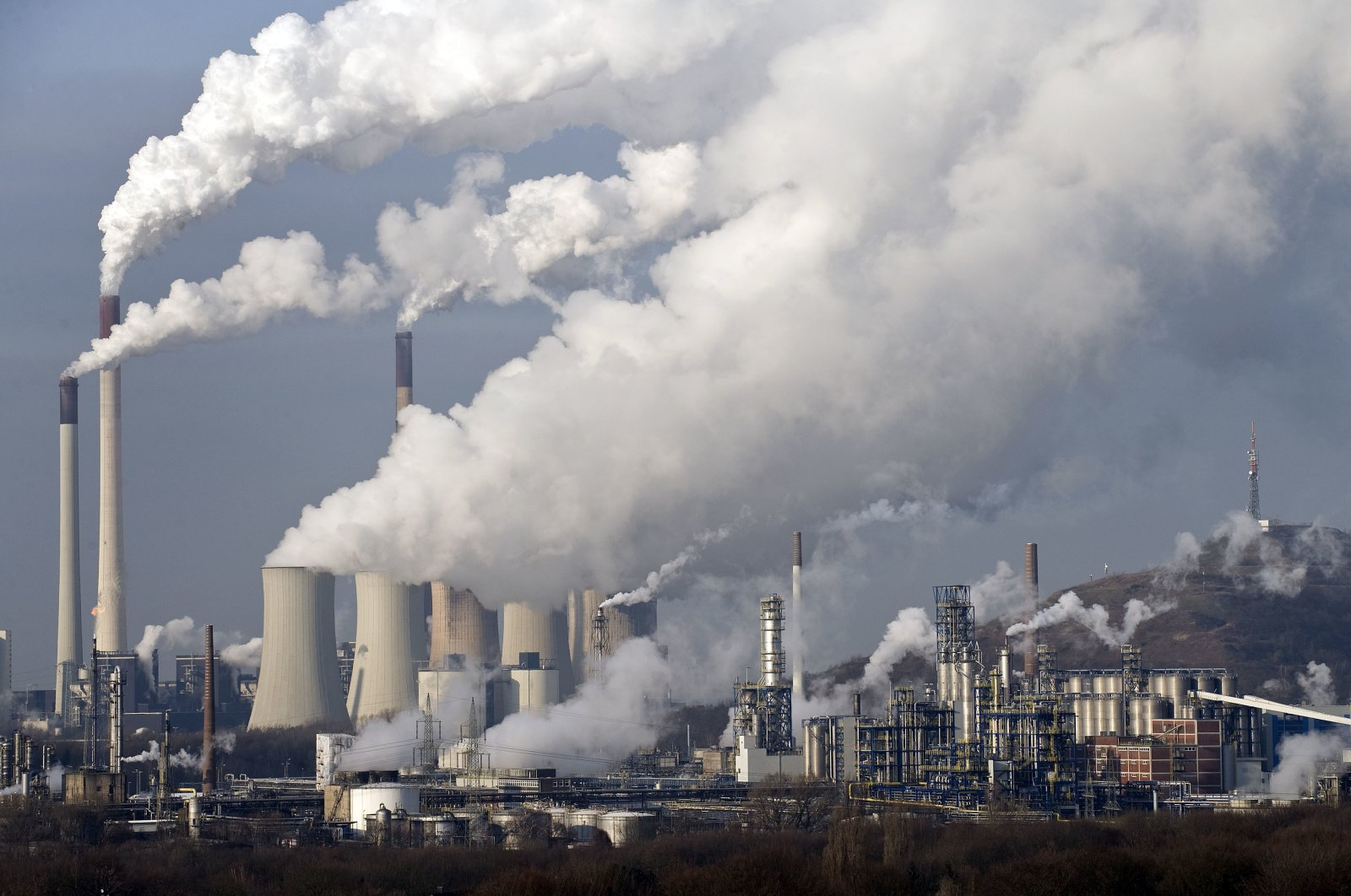 In this file photo, steam and smoke rise from a coal burning power plant in Gelsenkirchen, Germany, Dec. 16, 2009 (AP Photo)