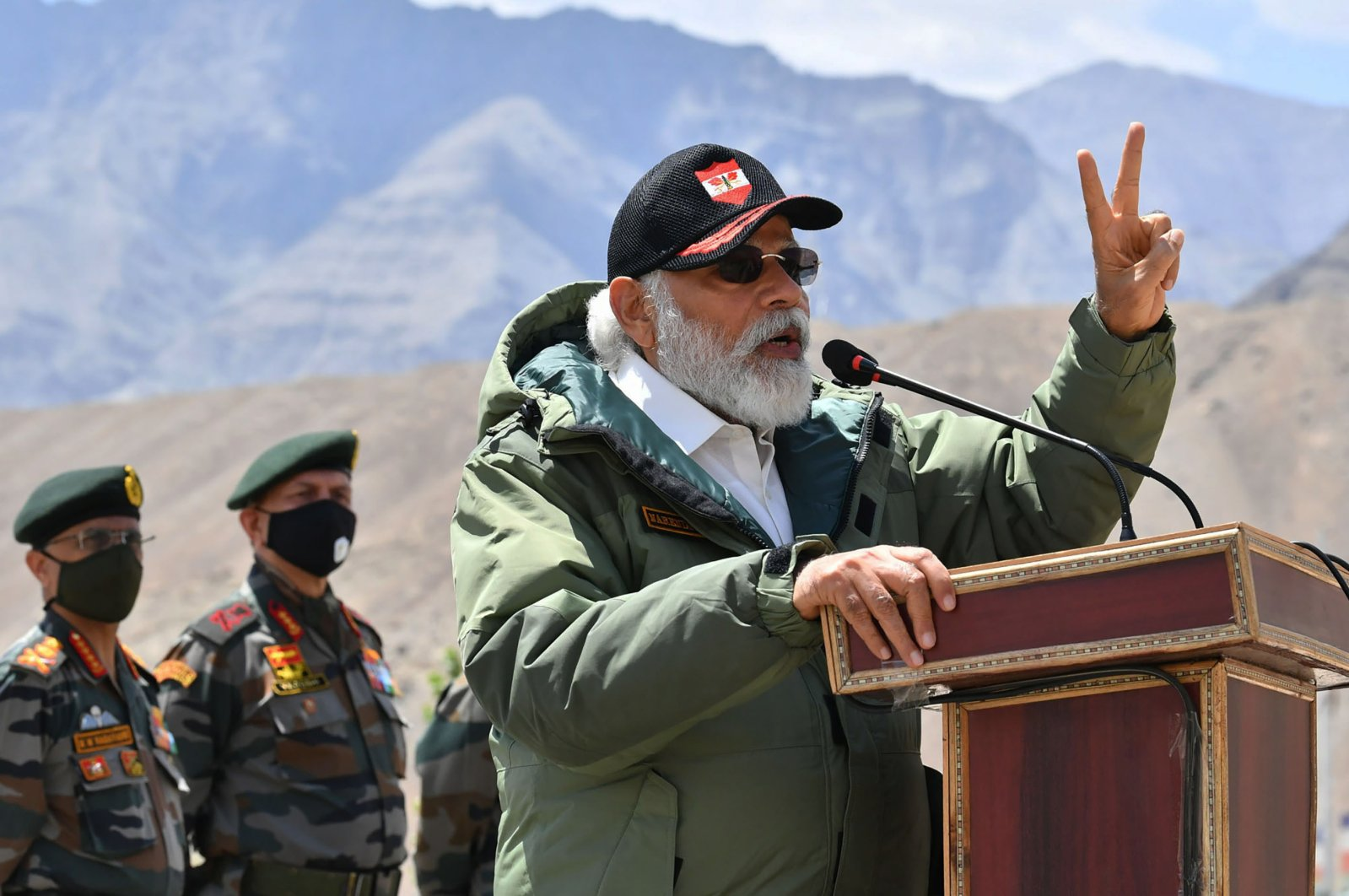 In this handout photo provided by the Press Information Bureau, Indian Prime Minister Narendra Modi adresses soldiers during a visit to Nimu, Ladakh area, India, Friday, July 3, 2020. (AP Photo)