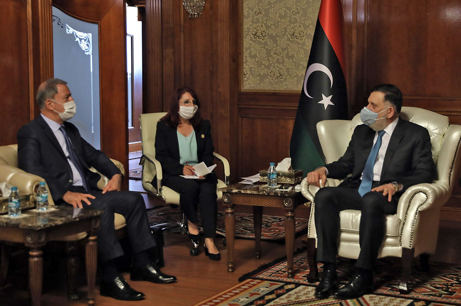 Fayez Sarraj (R), Prime Minister of Libya's U.N.-recognised Government of National Accord (GNA) receives Turkish Defense Minister Hulusi Akar (L), in the Libyan capital Tripoli, July 3, 2020. (AFP Photo)
