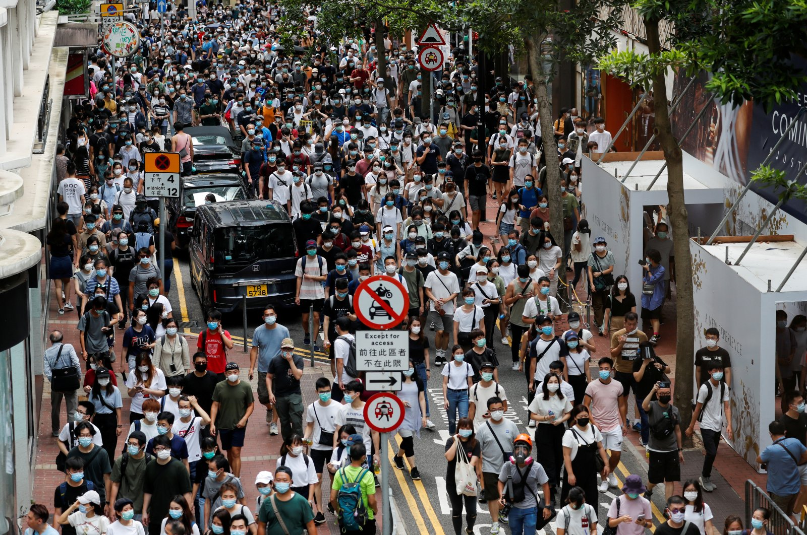 Anti-national security law protesters march at the anniversary of Hong Kong's handover to China from Britain, in Hong Kong, July 1, 2020. (REUTERS Photo)