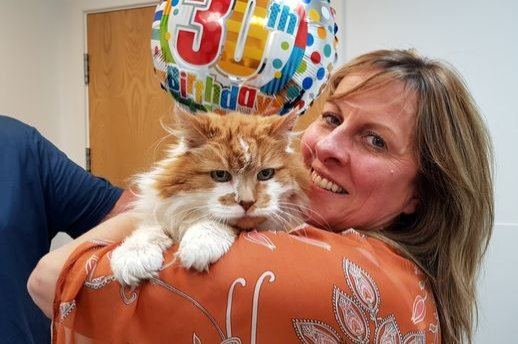 Rubble's owner Michele Heritage poses with her cat in his 30th birthday, June 4, 2020. (DHA Photo)