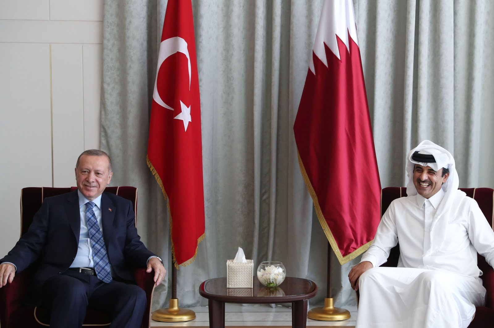 This handout picture provided by Qatar's Government Communications Office (GCO) on July 2, 2020 shows Emir Sheikh Tamim bin Hamad al-Thani (R) meeting with President Recep Tayyip Erdoğan in the capital Doha. (AFP Photo)