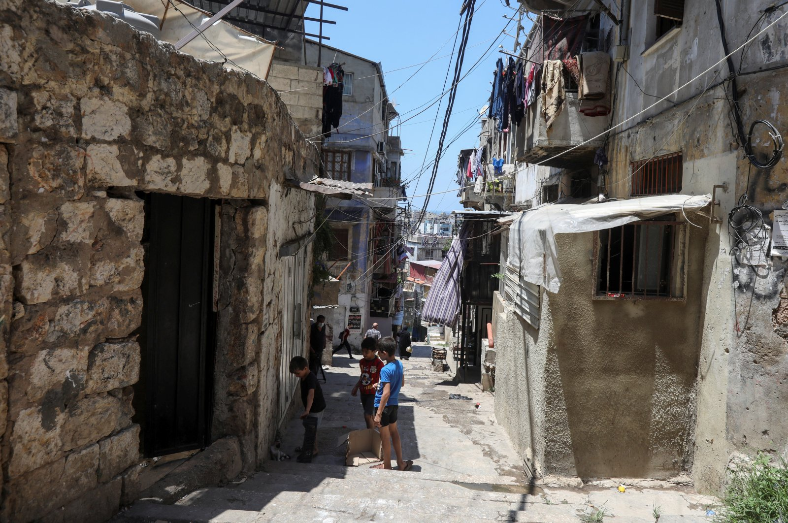Boys play along an alleyway in Tripoli, northern Lebanon July 1, 2020. Picture taken July 1, 2020. (REUTERS Photo)