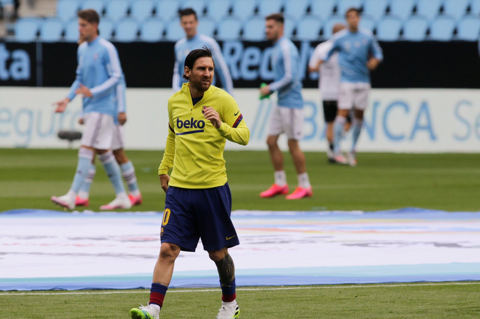 Barcelona's Lionel Messi during the warm-up before the match with Celta Vigo on June 27, 2020. (Reuters Photo)