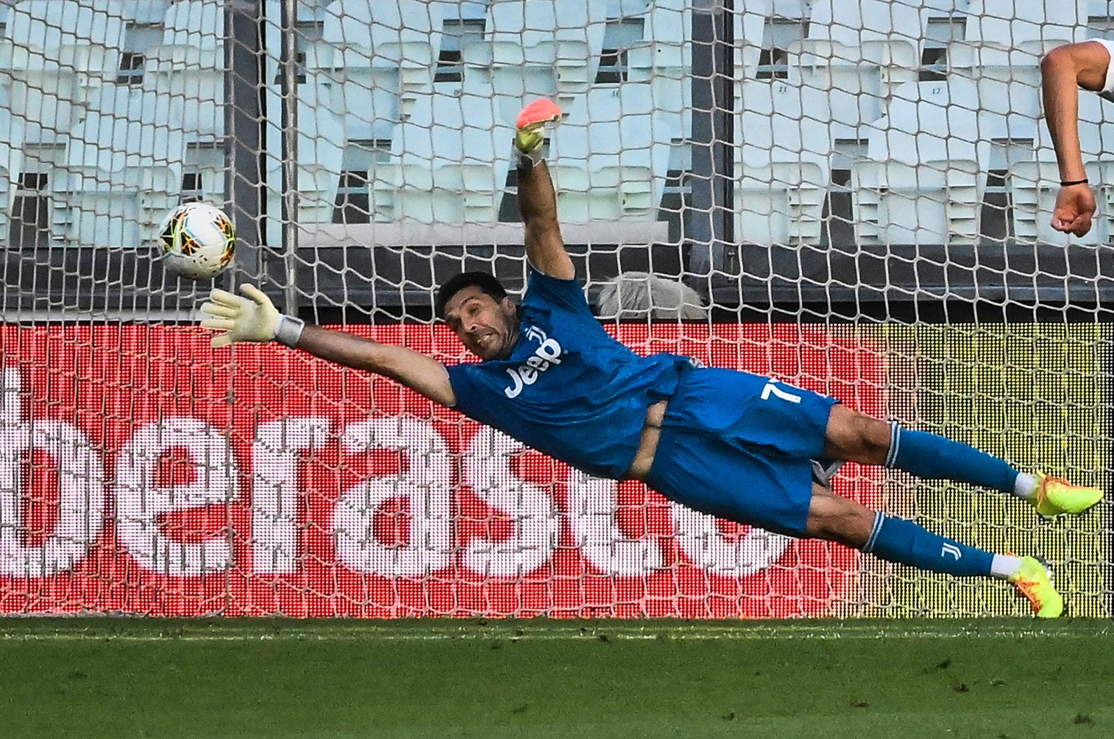 Juventus goalie Gianluigi Buffon makes a save during the Serie A football match between Juventus and Torino, at the Allianz Stadium in Turin, Italy, Saturday, July 4, 2020. (AFP Photo)