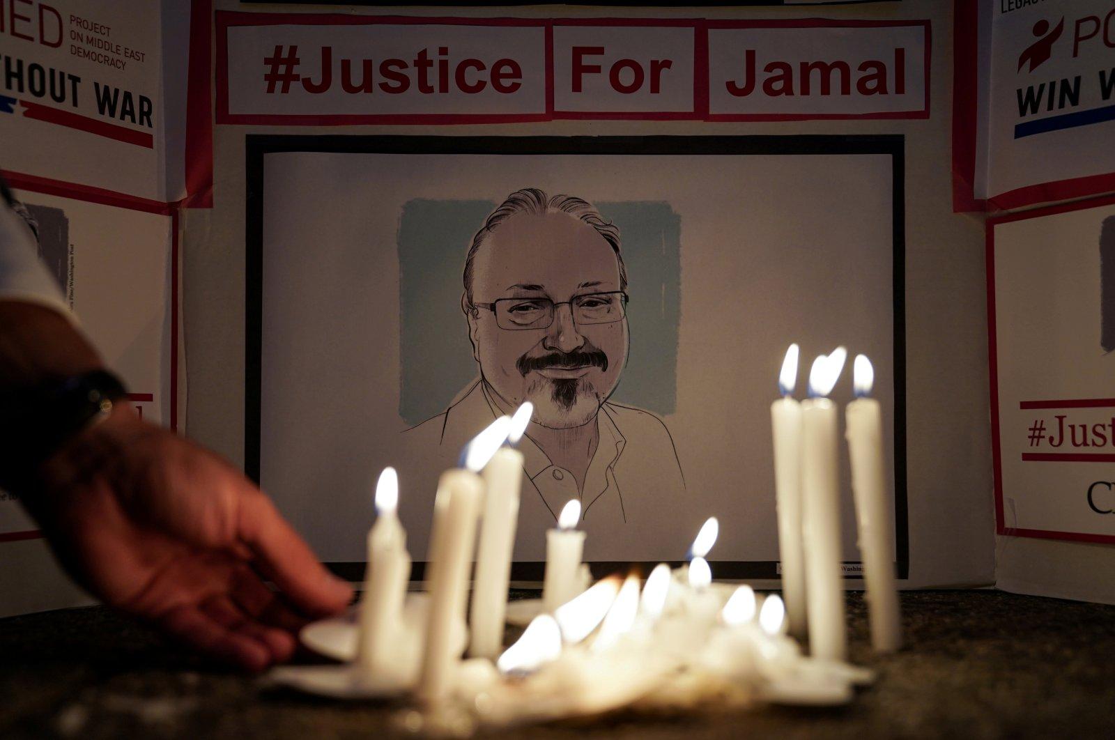 People hold a candlelight vigil to mark the anniversary of slain journalist Jamal Khashoggi, in front of the Saudi Embassy in Washington, D.C., Oct. 2, 2019. (Reuters Photo)