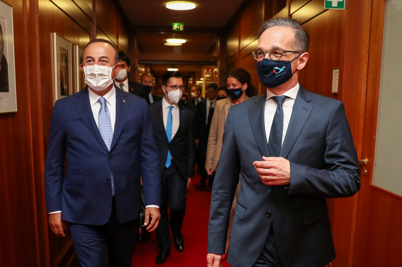 German Foreign Minister Heiko Maas and his Turkish counterpart Mevlut Cavusoglu, wearing protective face masks, walk before their meeting in Berlin, Germany July 2, 2020. (AA Photo)