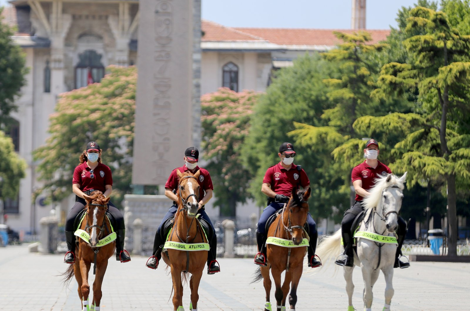 Mounted police officers patrol against people not wearing masks at Sultanahmet Square, in Istanbul, Turkey, July 4, 2020. (AA Photo)