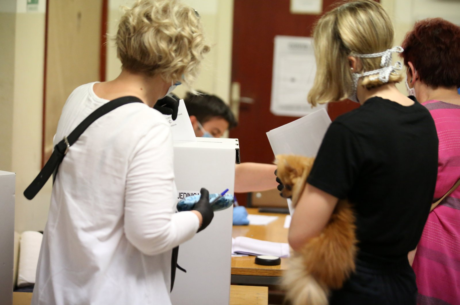 Croatian citizens cast their ballot papers at a polling station during the parliamentary elections, in downtown Zagreb, Croatia, July 5, 2020. (EPA Photo)