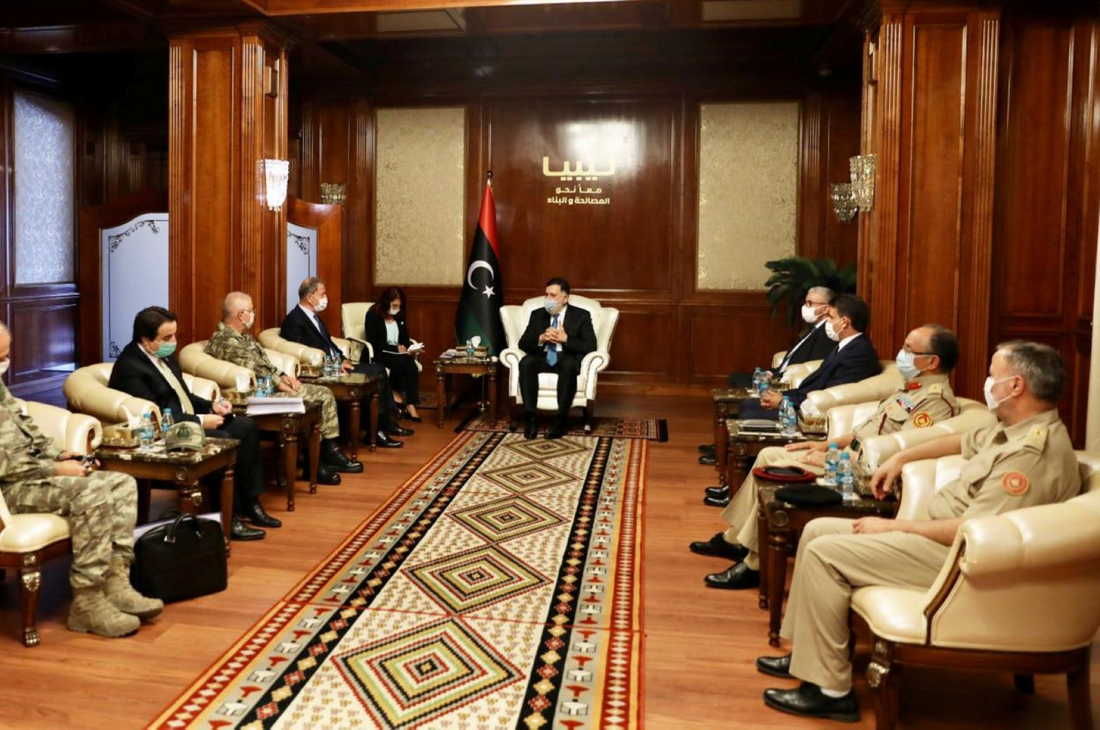 Defense Minister Hulusi Akar during a meeting with Libya's internationally recognized Prime Minister Fayez al-Sarraj in Tripoli, Libya, July 3, 2020. (Reuters Photo)