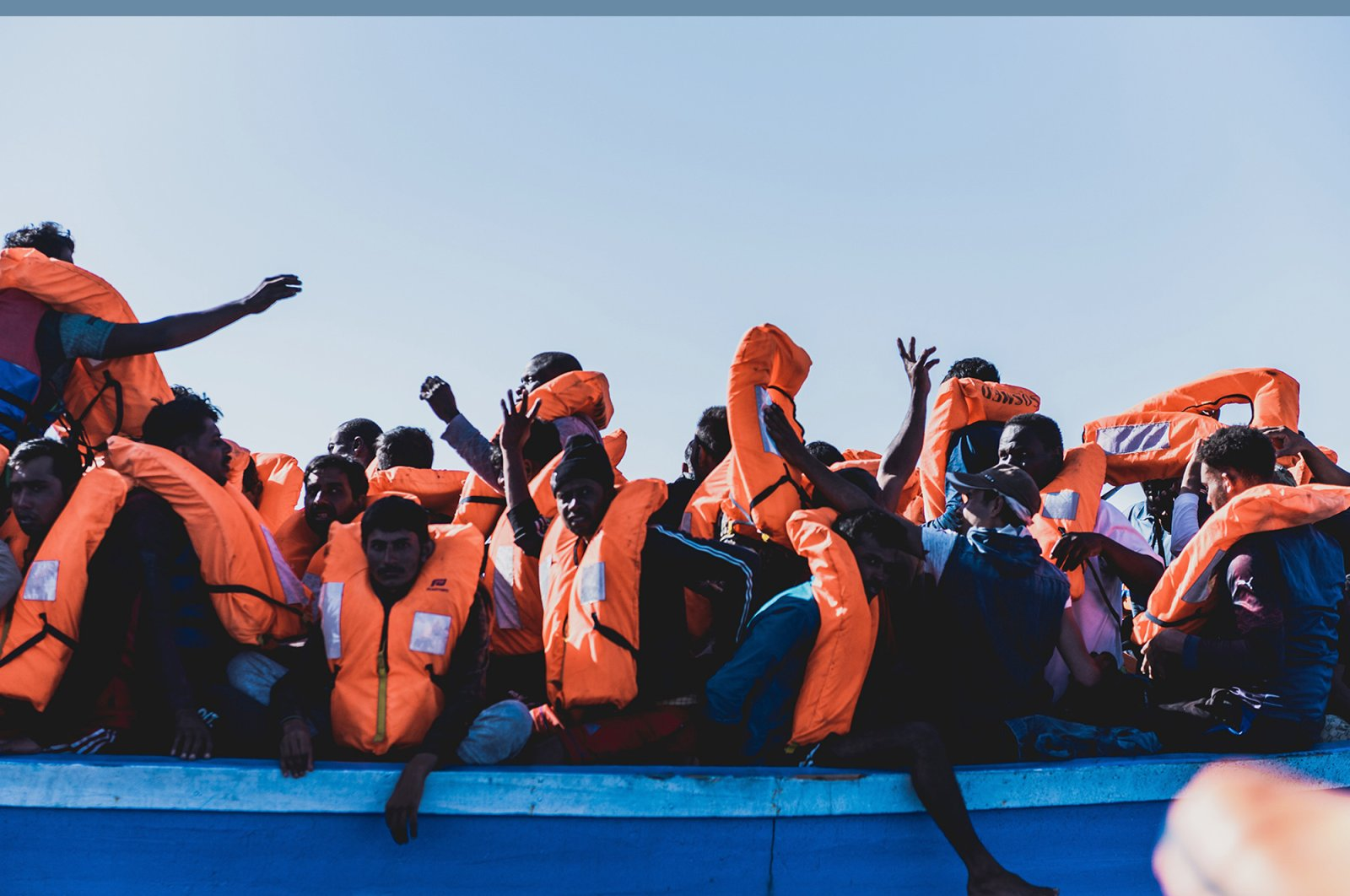 Migrants on a boat wear life jackets after being rescued in the Mediterranean Sea, June 30, 2020. (AP Photo)