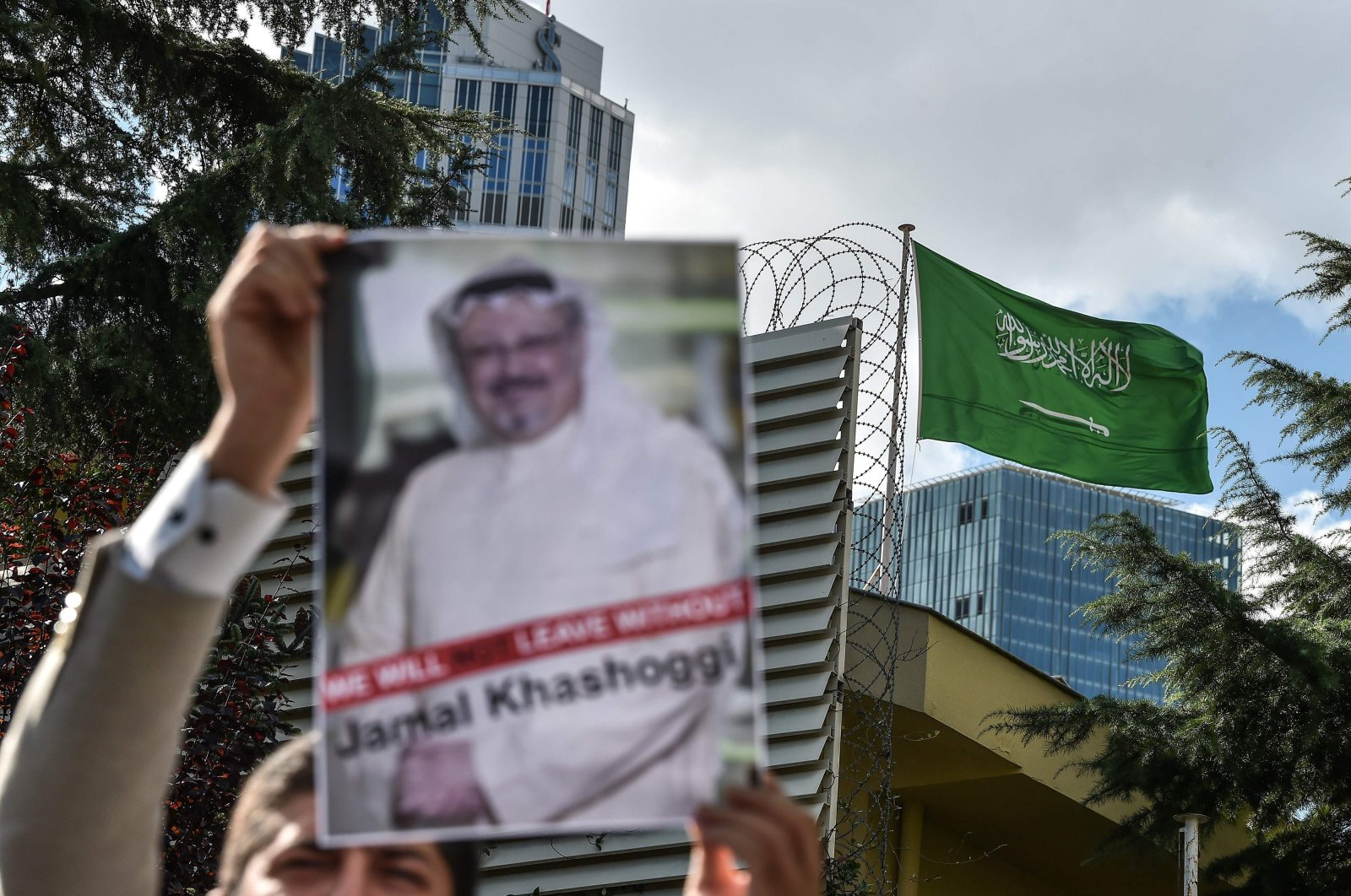 In this file photo taken on Oct. 5, 2018, a protester holds a picture of journalist Jamal Khashoggi in front of the Saudi Consulate in Istanbul (AFP Photo)