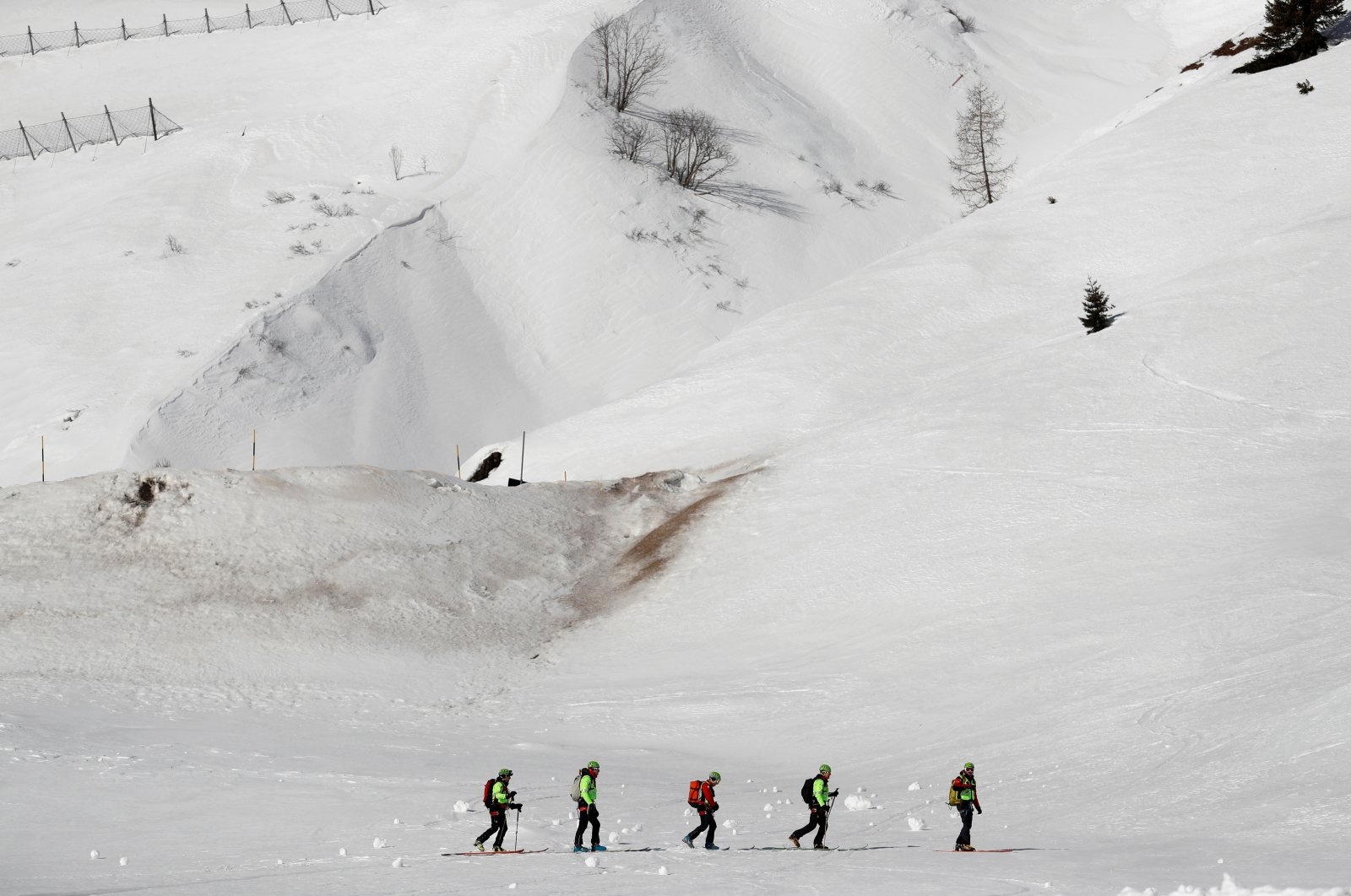 Italian alpine rescuers participate in an avalanche rescue training exercise in Passo Fedaia, Italy, Feb. 11, 2020. (Reuters Photo)