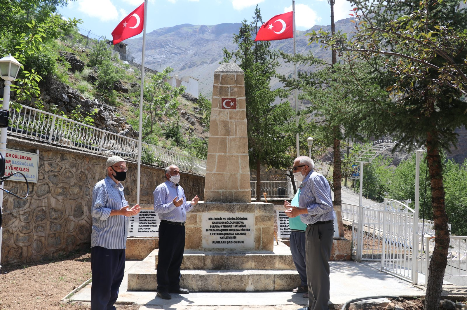 Villagers pray at a monument dedicated to the victims of a terrorist attack in the village of Başbağlar, Erzincan, Turkey, July 3, 2020. (AA Photo)