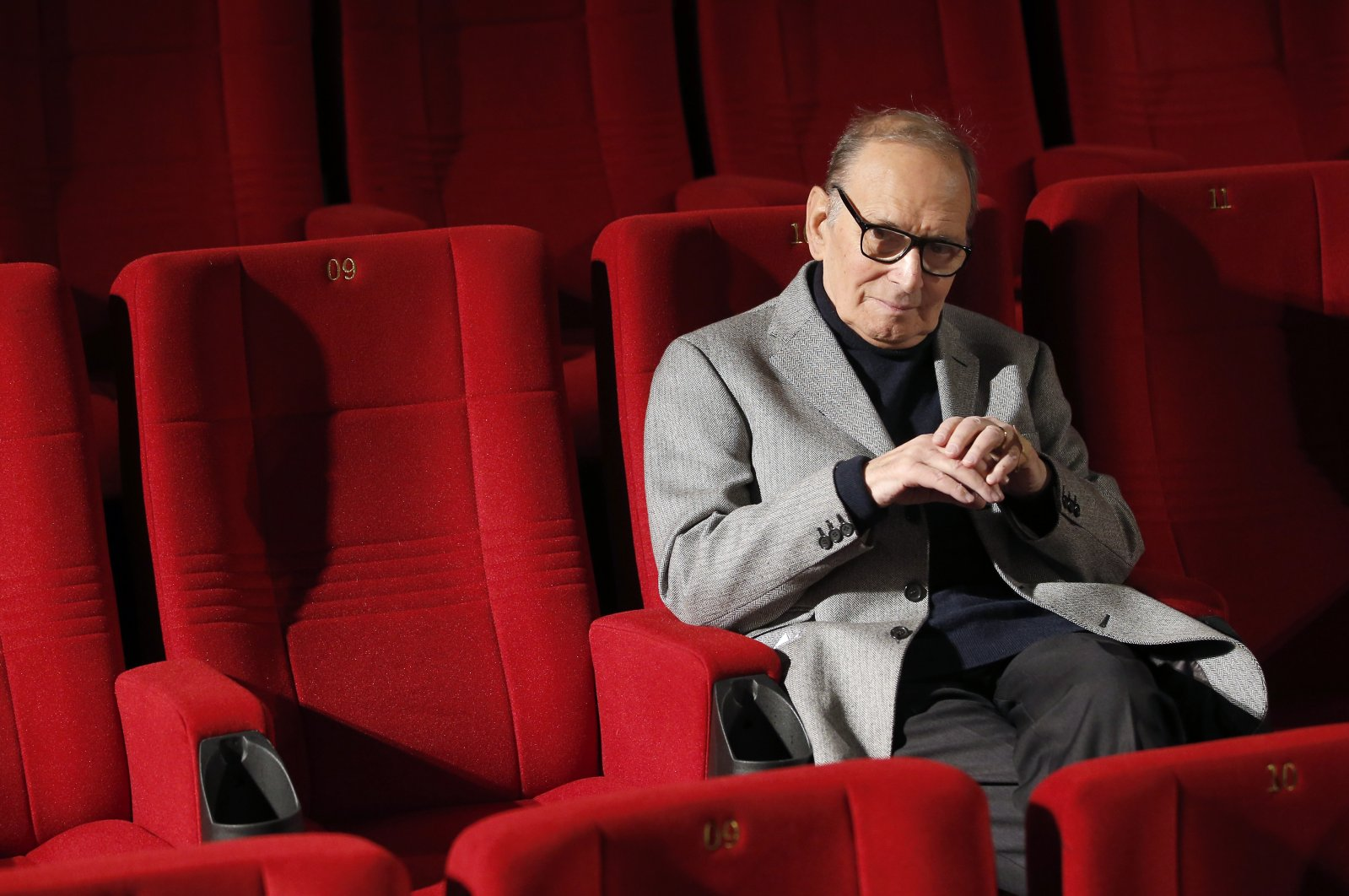 Italian composer Ennio Morricone poses during a photo call to promote his German 2014 concerts, in Berlin, Germany, Dec. 6, 2013. (AP Photo)