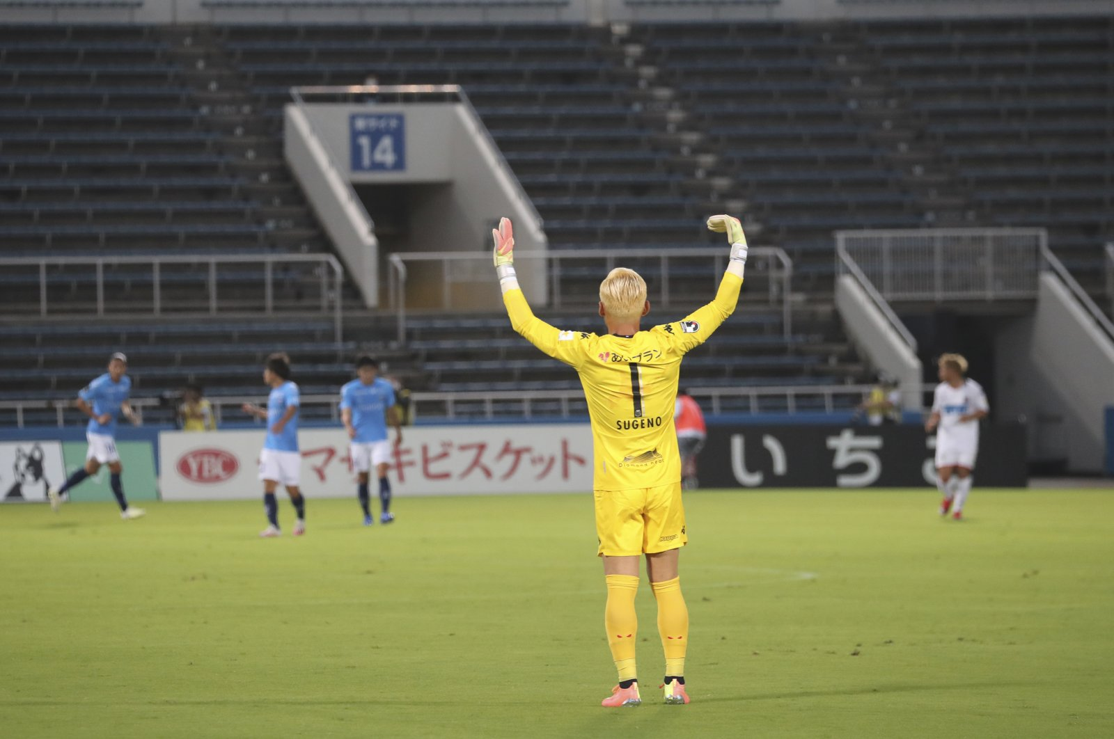 A view of the match between Consadole Sapporo GK and Yokohama FC without fans, in Yokohama, Japan, July 4, 2020. (AP Photo)