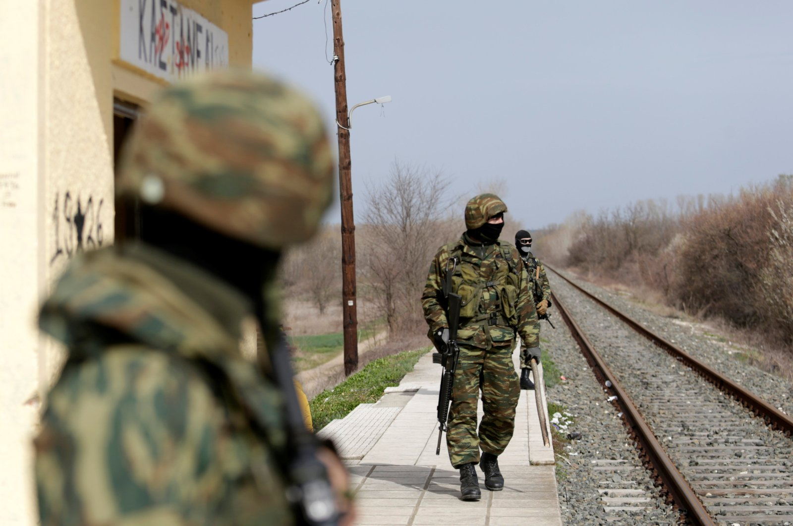 Greek soldiers secure a train station near Turkey's Pazarkule border crossing, in Kastanies, Greece March 8, 2020. (Reuters File Photo)