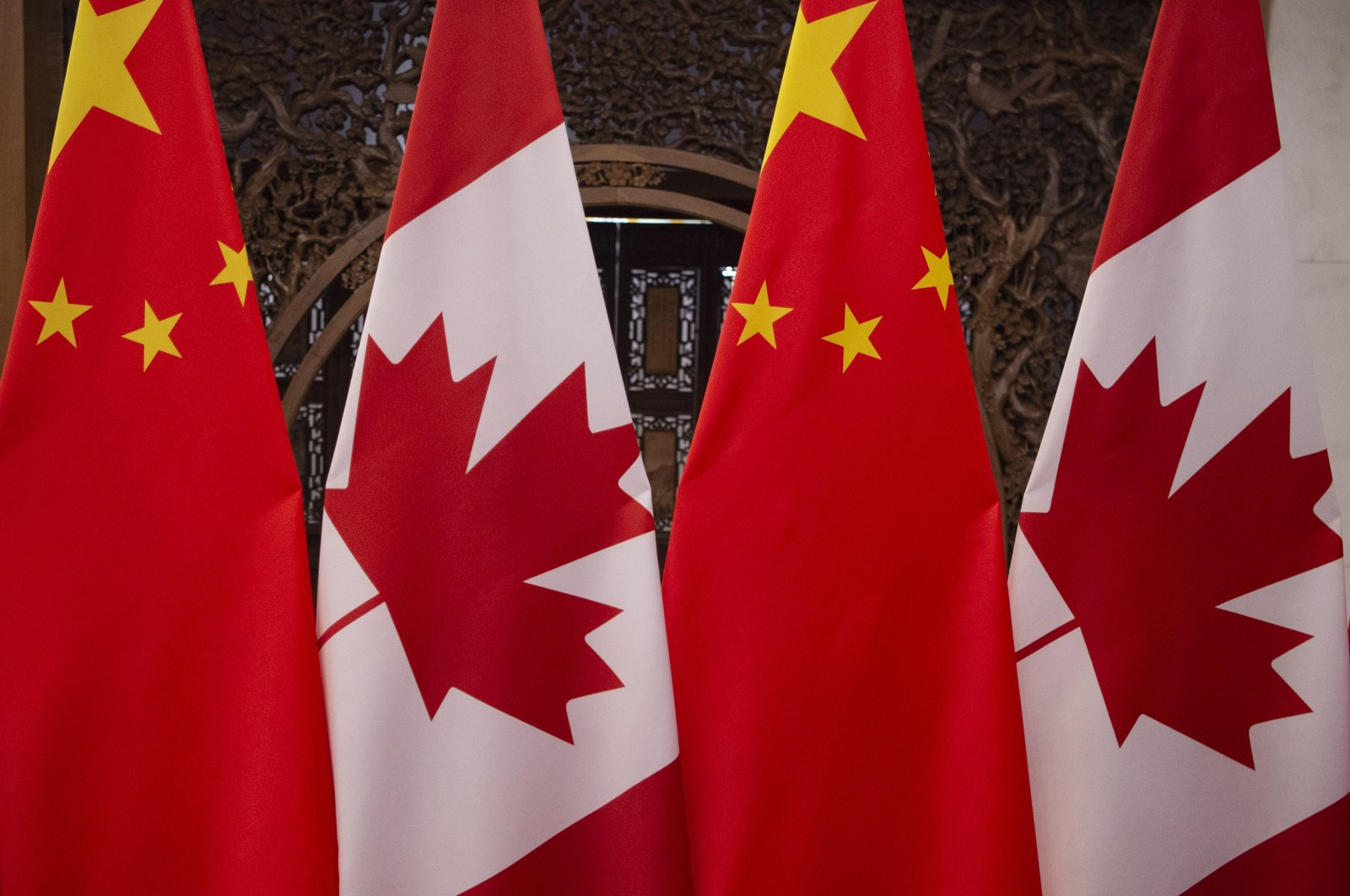 Canadian and Chinese flags are seen prior to a meeting with Canada's Prime Minister Justin Trudeau and China's President Xi Jinping at the Diaoyutai State Guesthouse in Beijing, China, Dec. 5, 2017. (AFP Photo)