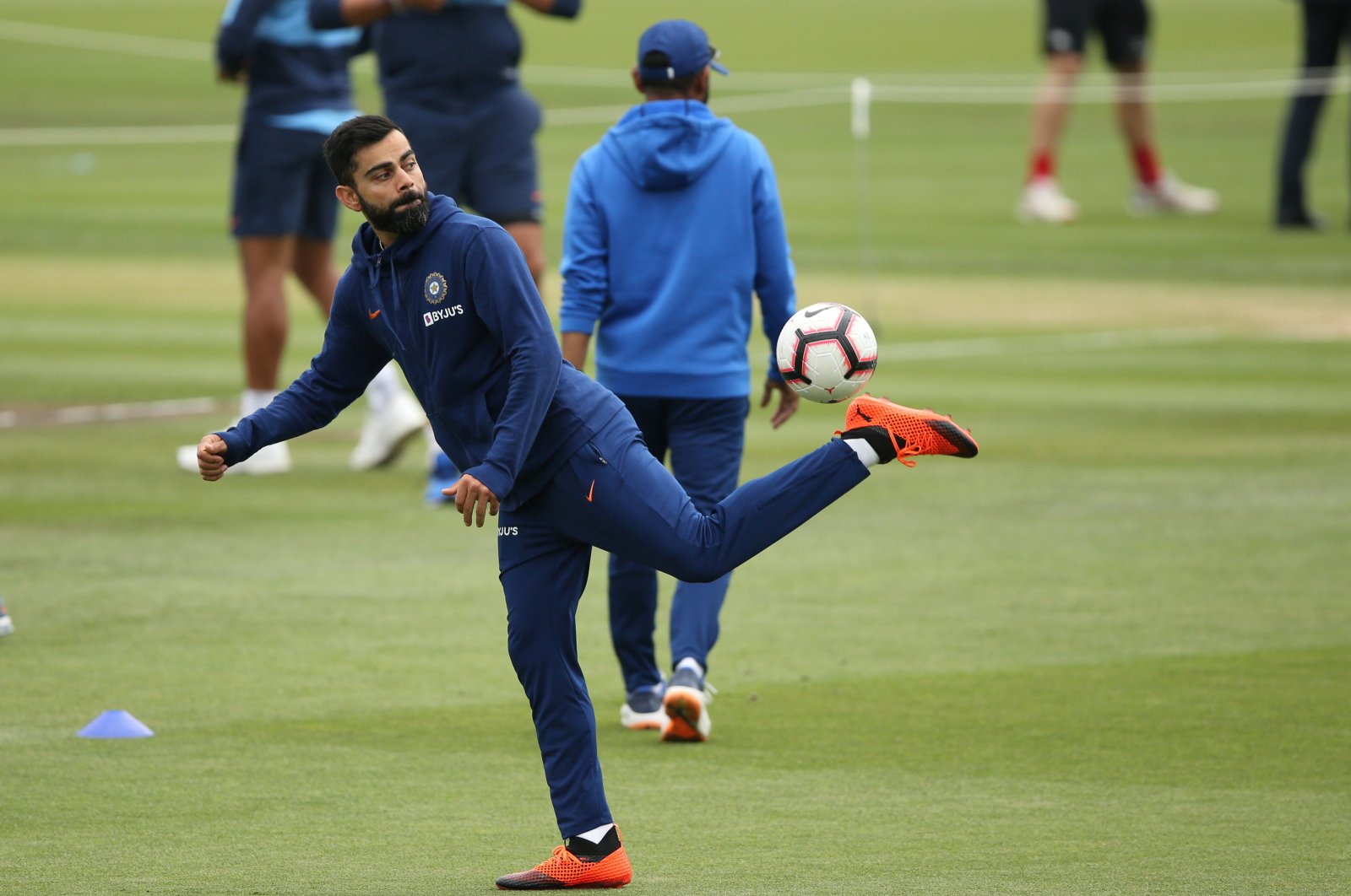 India's Virat Kohli with a soccer ball during the warmup before a cricket match, in Christchurch, New Zealand, March 2, 2020. (REUTERS Photo)