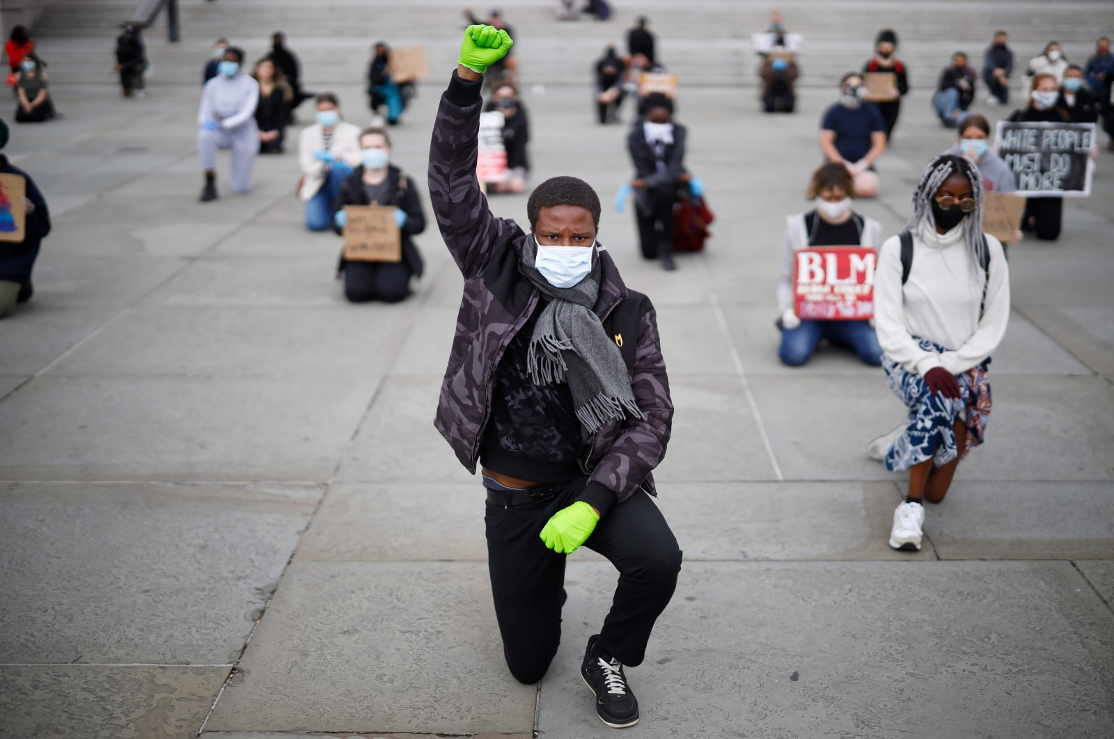 A protester makes a Black Lives Matter fist at a demonstration in Trafalgar Square in central London, to show solidarity with the Black Lives Matter movement in the wake of the killing of George Floyd, Britain, June 5, 2020. (AFP Photo)