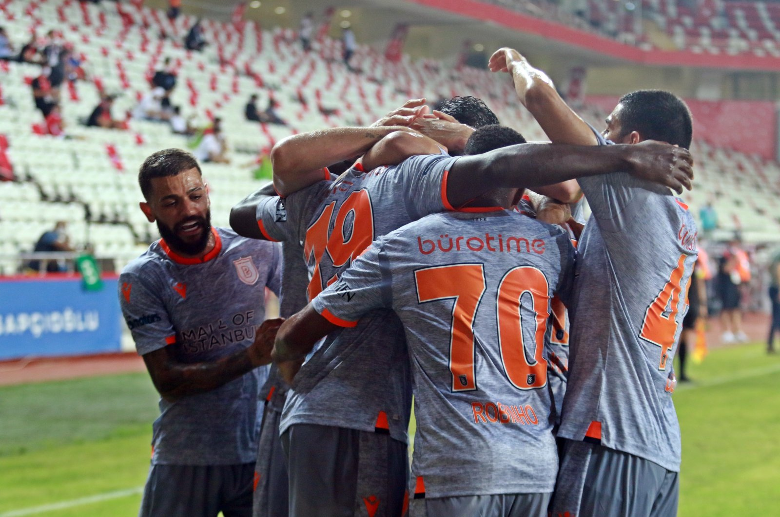 Başakşehir players celebrate victory against Antalyaspor, in Antalya, Turkey, July 4, 2020. (İHA Photo)