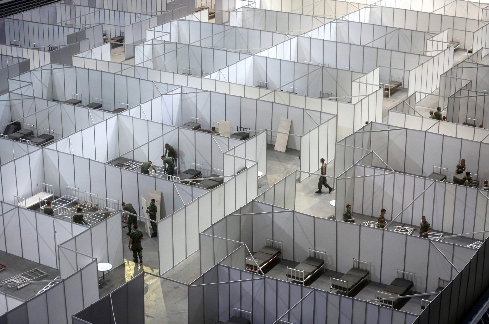 Serbian army soldiers prepare a makeshift field hospital to accomodate patients infected by COVID-19 inside the Belgrade Arena, on July 6, 2020. (AFP Photo)