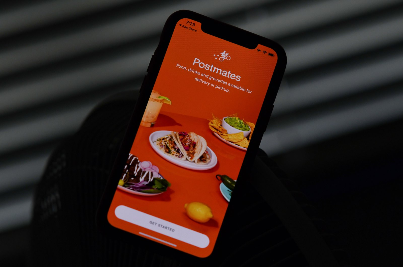 This illustration photo shows the delivery app Postmates on a smartphone screen in Los Angeles, California, U.S., June 30, 2020. (AFP Photo)