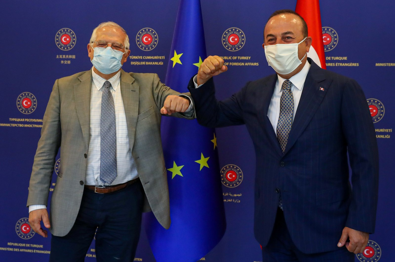 Foreign Minister Mevlüt Çavuşoğlu and Josep Borrell Fontelles, High Representative of the European Union for Foreign Affairs and Security Policy, both wearing protective face masks, pose before their meeting in Ankara, Turkey, July 6, 2020. (Turkish Foreign Ministry/Handout via Reuters)