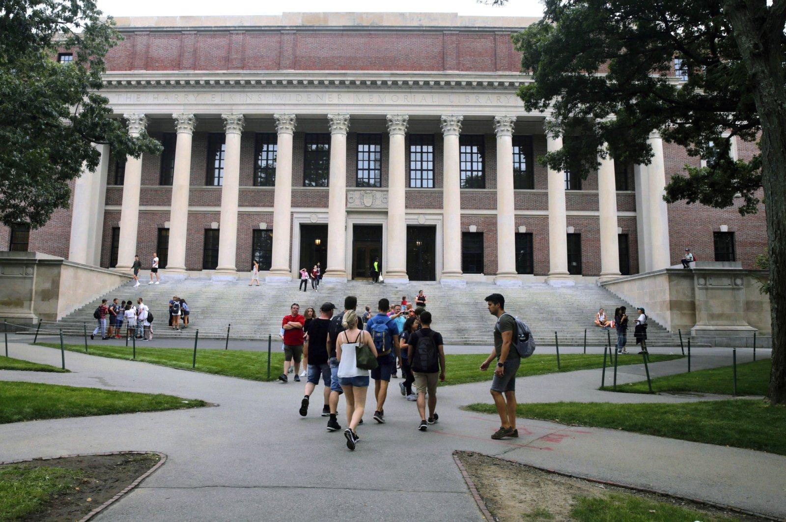 Students walk near the Widener Library at Harvard University in Cambridge, Mass., U.S., Aug. 13, 2019. (AP Photo)
