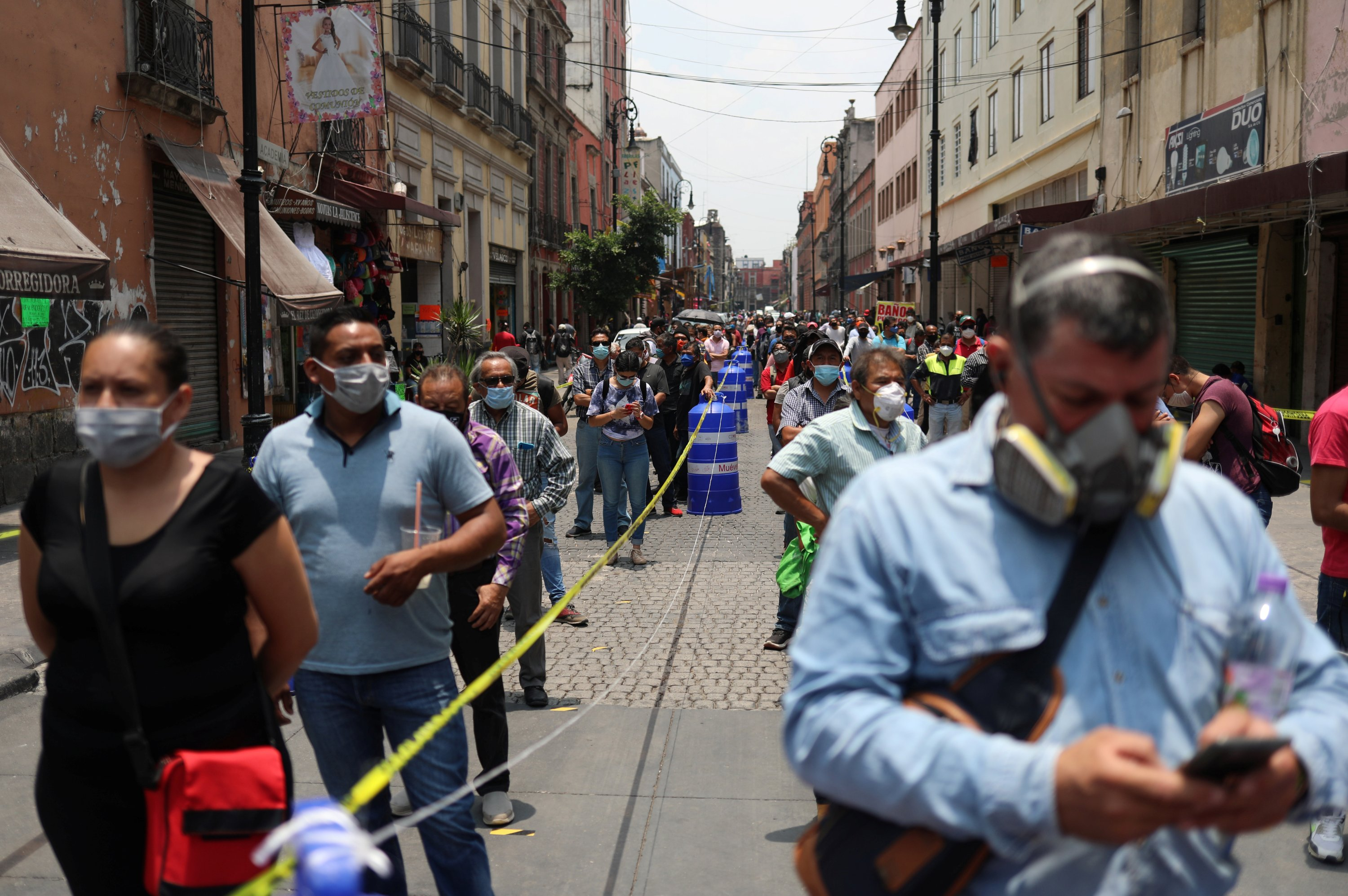 People wait in line during the gradual reopening of commercial activity in Mexico City, Mexico, July 6, 2020. (REUTERS Photo)