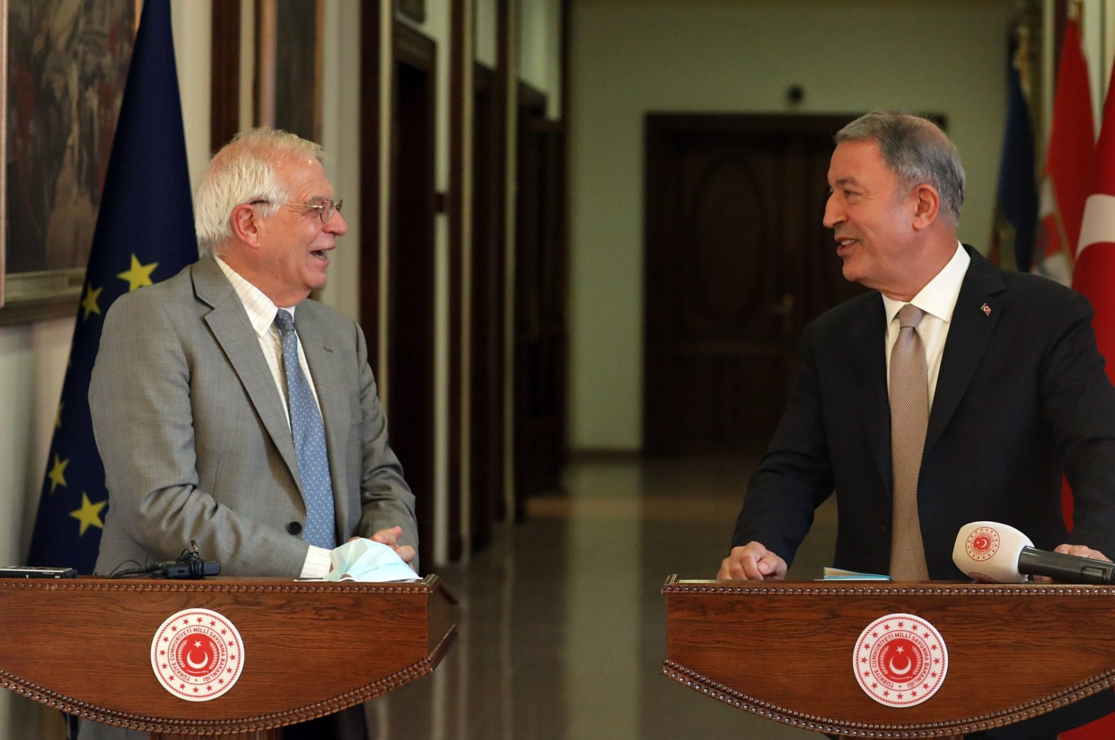 Defense Minister Hulusi Akar (Right) smiles during a news conference with EU foreign policy chief Josep Borrell in Ankara on Monday, July 6, 2020 (IHA Photo)
