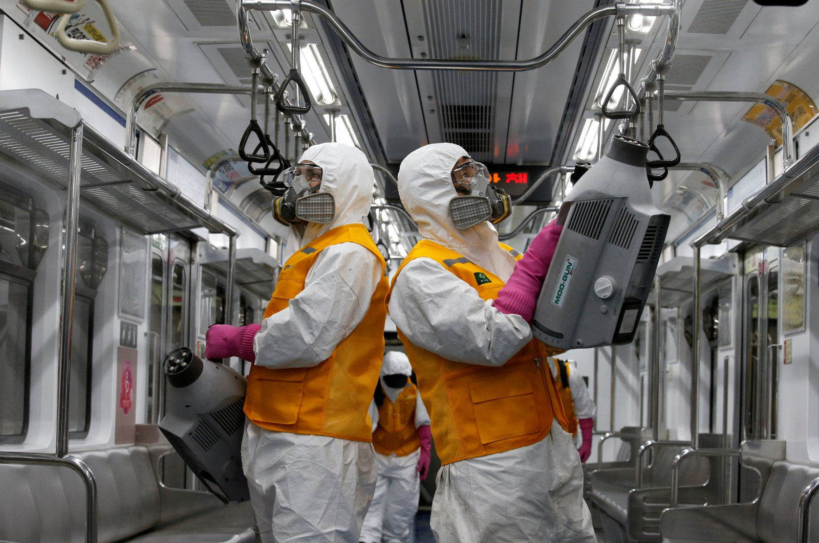 Employees from a disinfection service sanitize a subway car depot amid coronavirus fears in Seoul, South Korea, March 11, 2020. (REUTERS Photo)