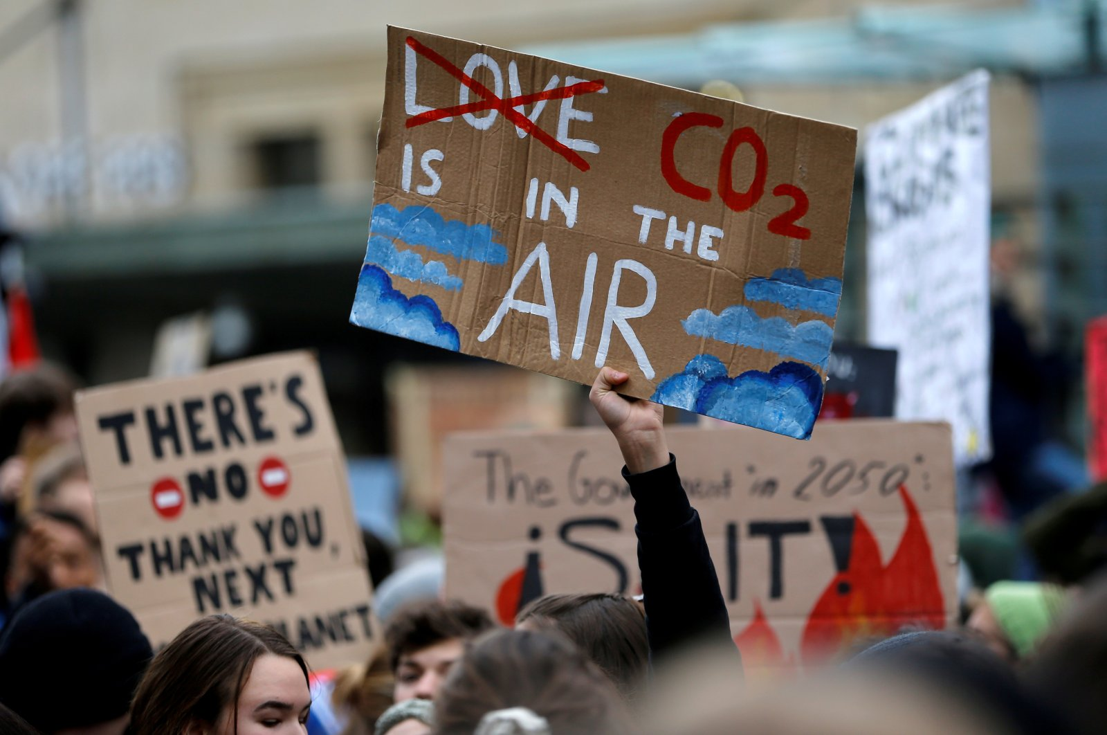 A climate change activist holds a sign during a demonstration of the Fridays for Future movement in Lausanne, Switzerland January 17, 2020. (Reuters Photo)