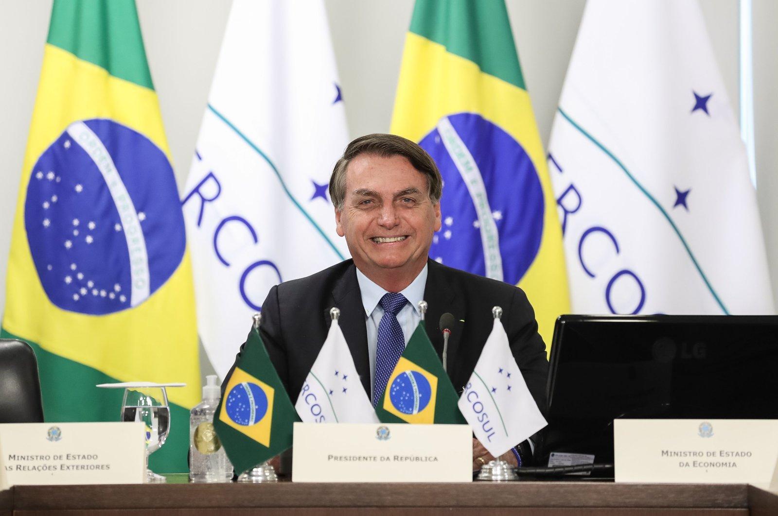 Brazilian President Jair Bolsonaro smiles during the first Mercosur Summit held via videoconference due to the coronavirus pandemic, Brazil, July 2, 2020. (AFP Photo)