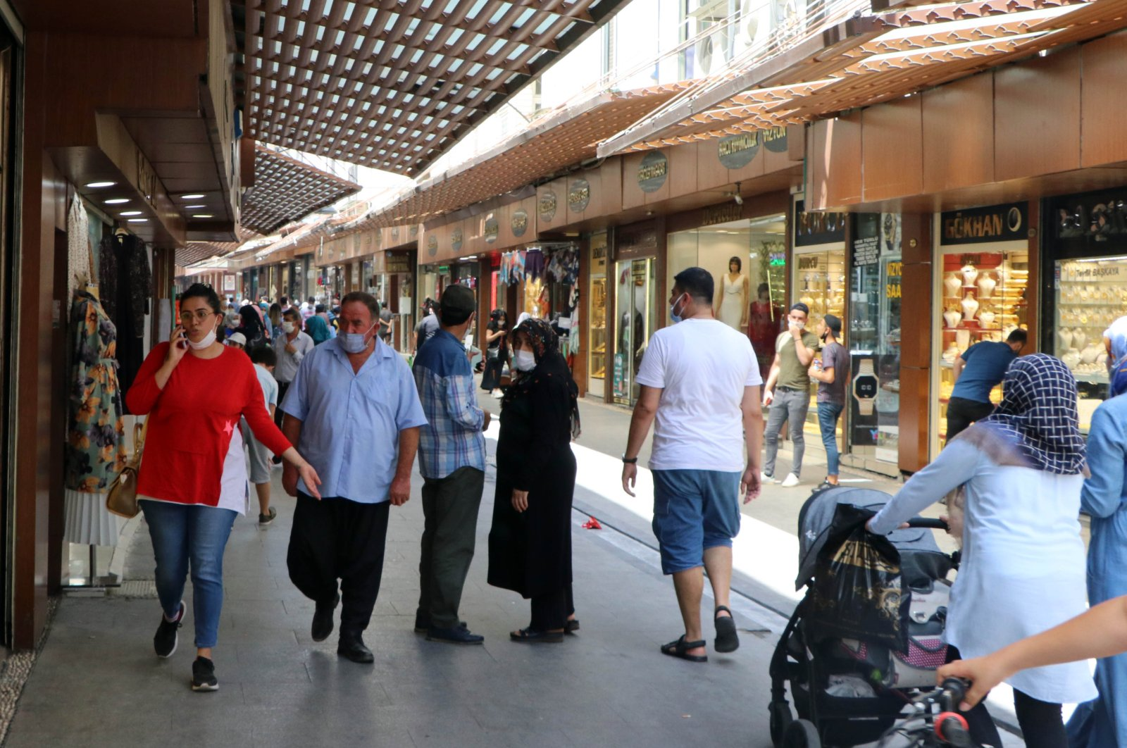 People walk on a street in Gaziantep, Turkey where daily cases rose recently, June 7, 2020. (DHA Photo)