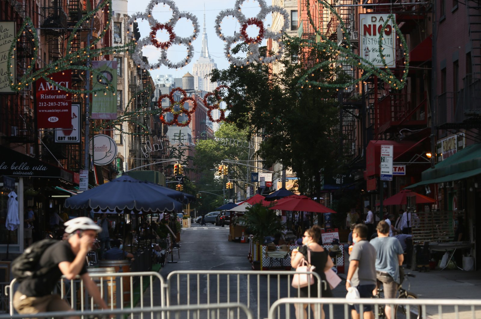 People dine outside on Mulberry Street in Lower Manhattan, New York City, New York, U.S., July 4, 2020. (Reuters Photo)