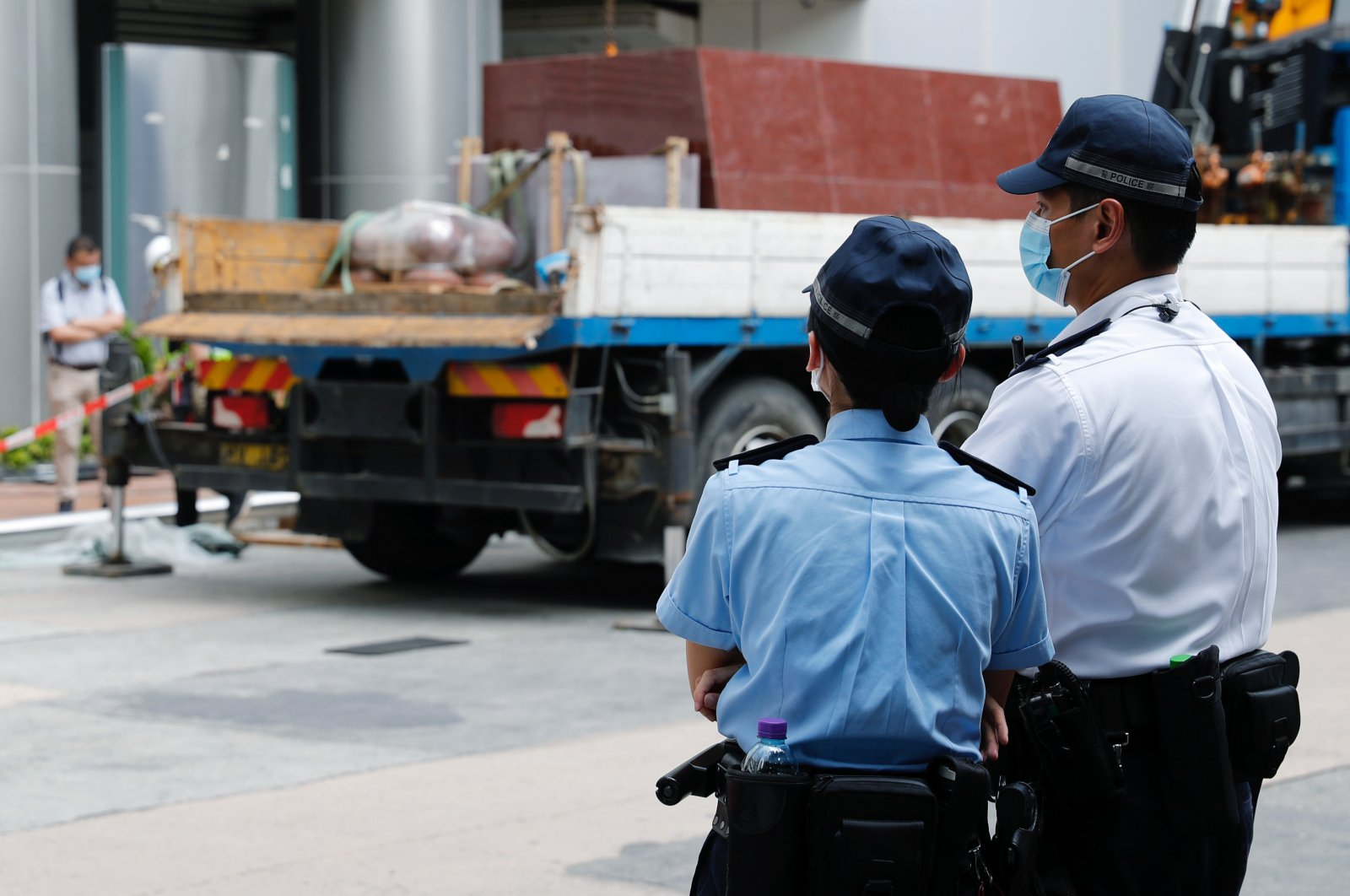 Police officers stand guard outside Metropark Hotel Causeway Bay Hong Kong believed to be used as the temporary national security agency in the city, Hong Kong, July 7, 2020. (REUTERS Photo)