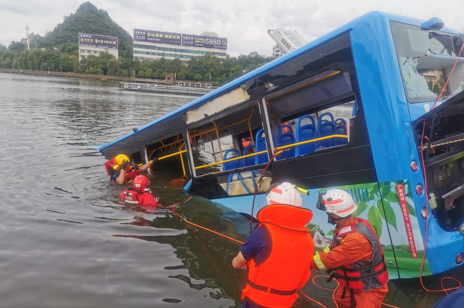 Rescue workers are seen at the site where a bus carrying students plunged into a reservoir, in Anshun, Guizhou province, China, July 7, 2020. (China Daily Photo via Reuters)