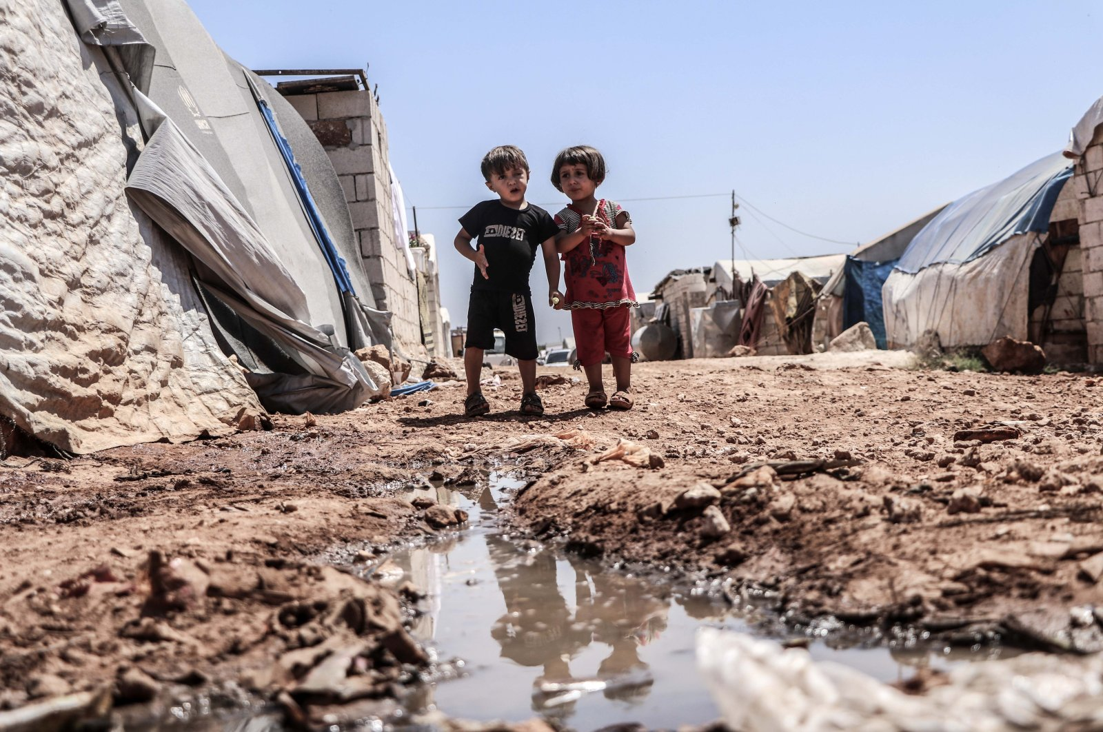 Infrastructural problems, including open cesspools and damaged sewer systems, threaten the health of displaced Syrians living in Idlib's camps. The picture was taken in the Khair Al-Sham camp in northern Syria, July 7, 2020. (AA Photo)