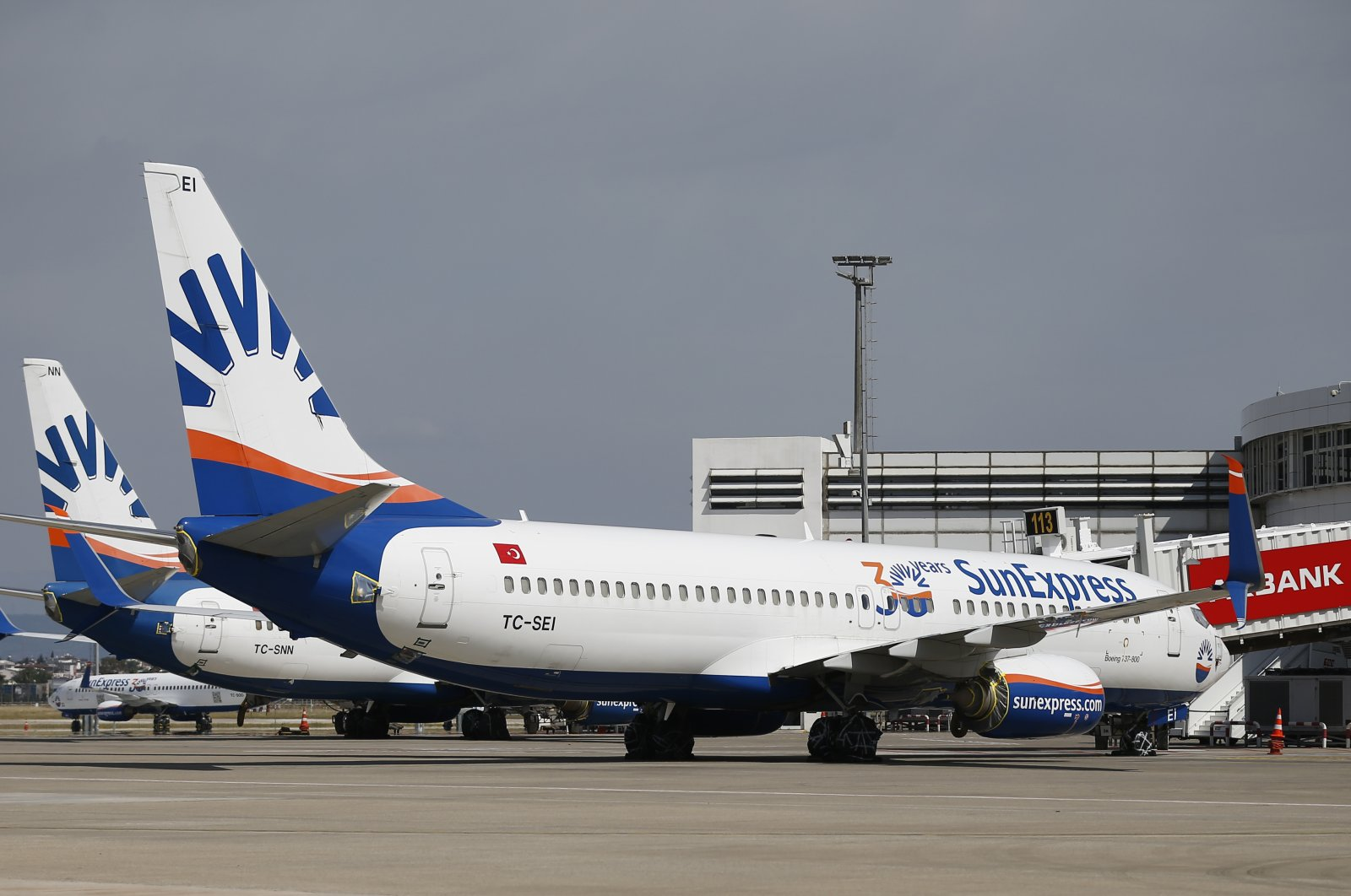 In this file photo, SunExpress planes sit parked at the gate of the Antalya Airport in Antalya, Turkey. (AA Photo)