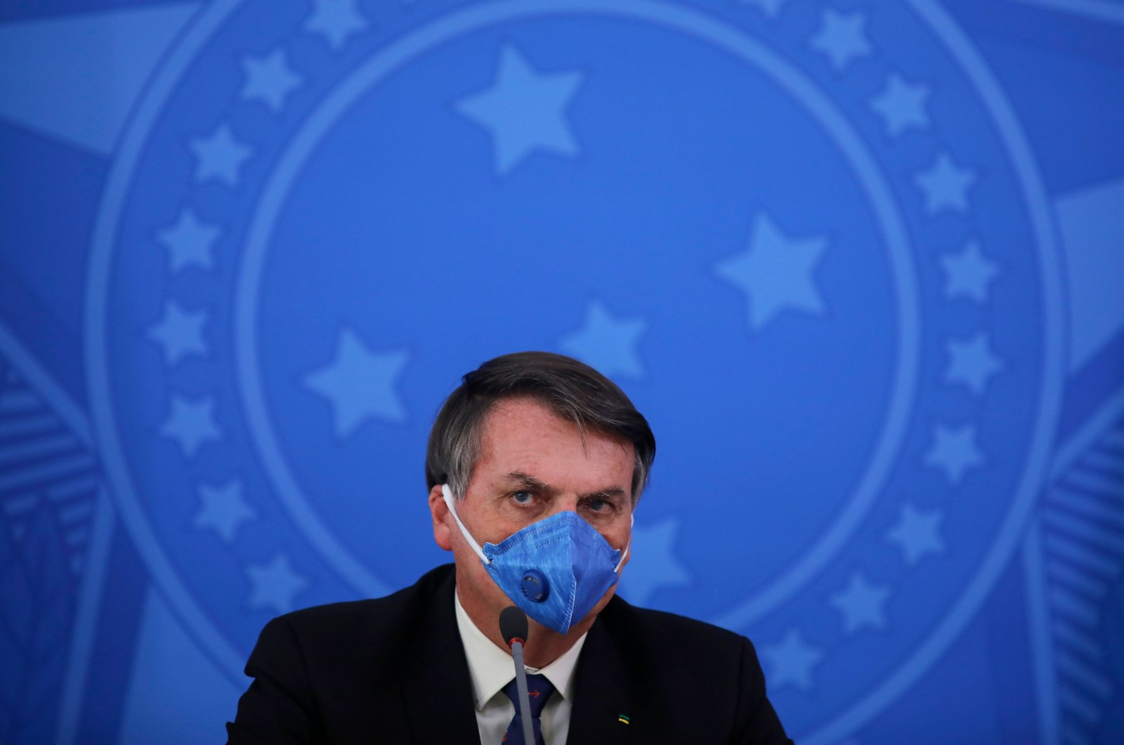 Brazil's President Jair Bolsonaro wears a face mask during a press conference on the coronavirus pandemic at the Planalto Palace in Brasilia, Brazil, March 20, 2020. (AFP Photo)